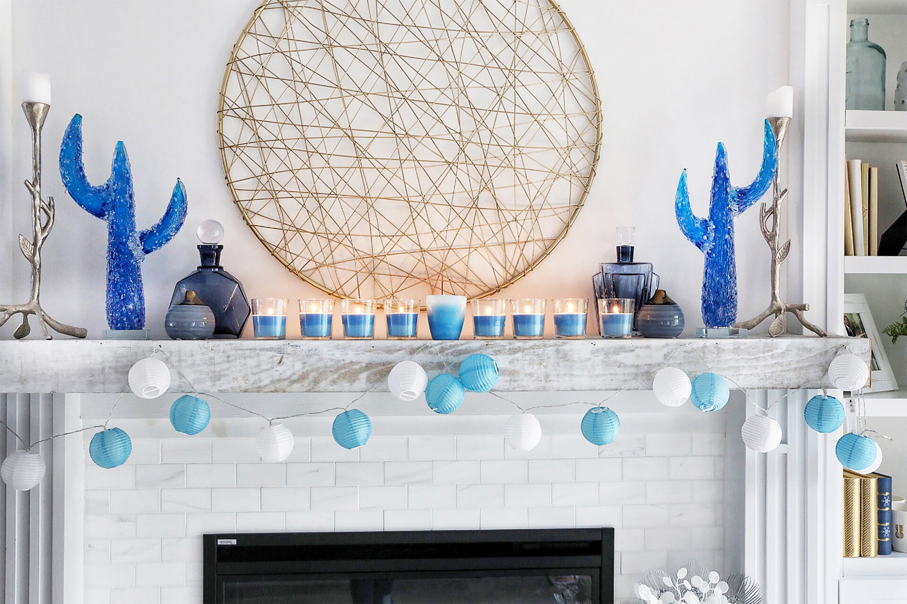 mantel decorated with blue crayon menorah candles