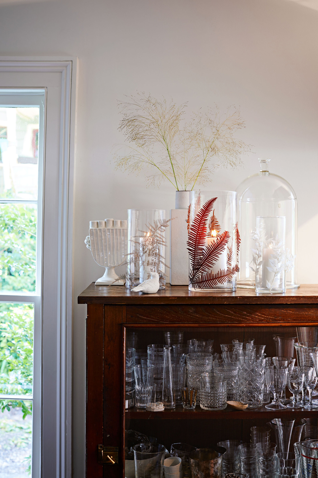 glass candle containers decorated with dried flowers