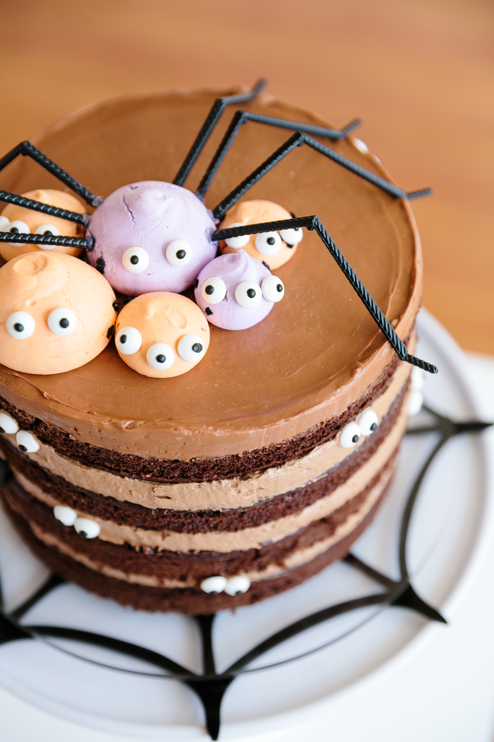 Halloween cake with chocolate frosting and edible spider decorations