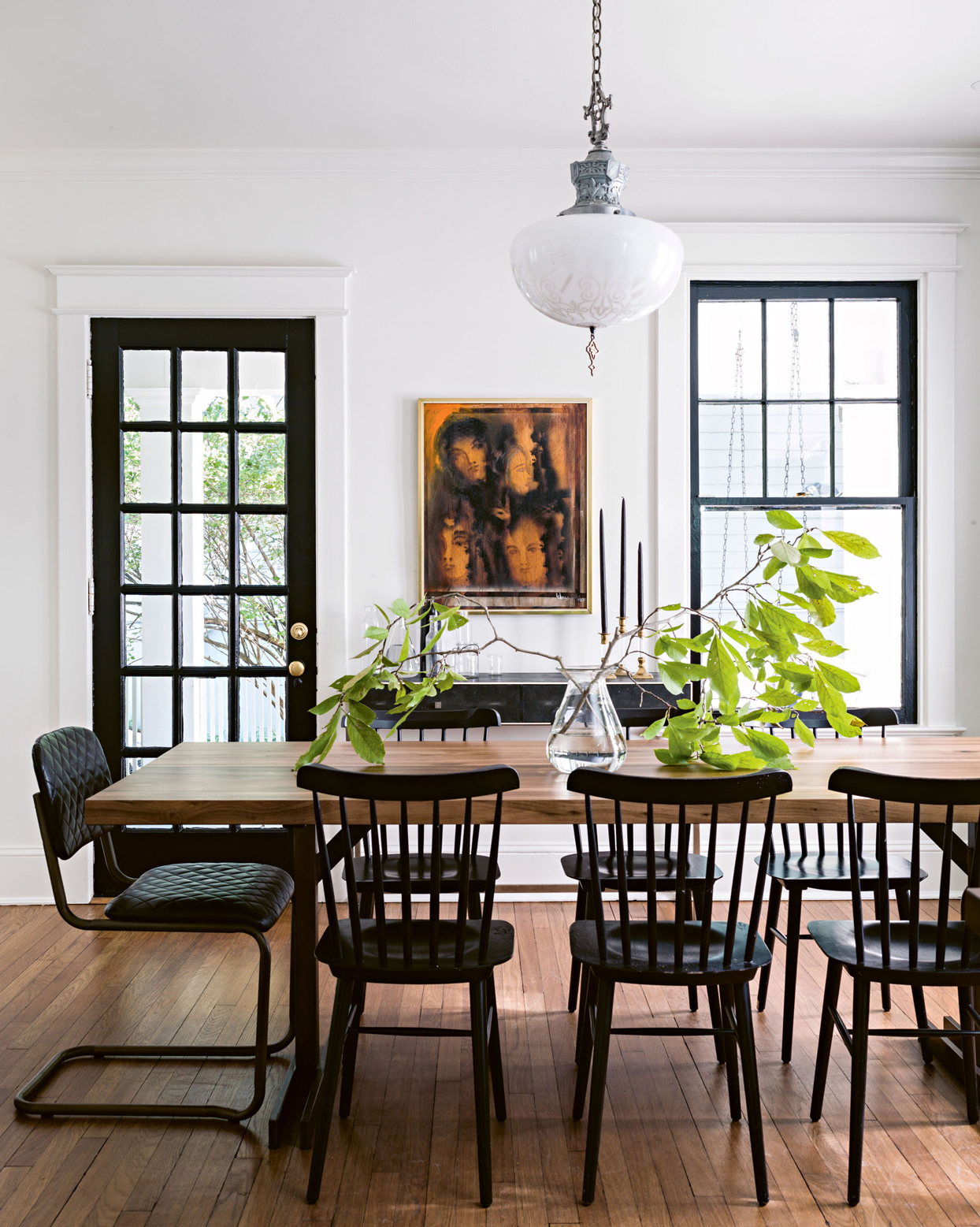 white dining room with vintage oak table and black accents