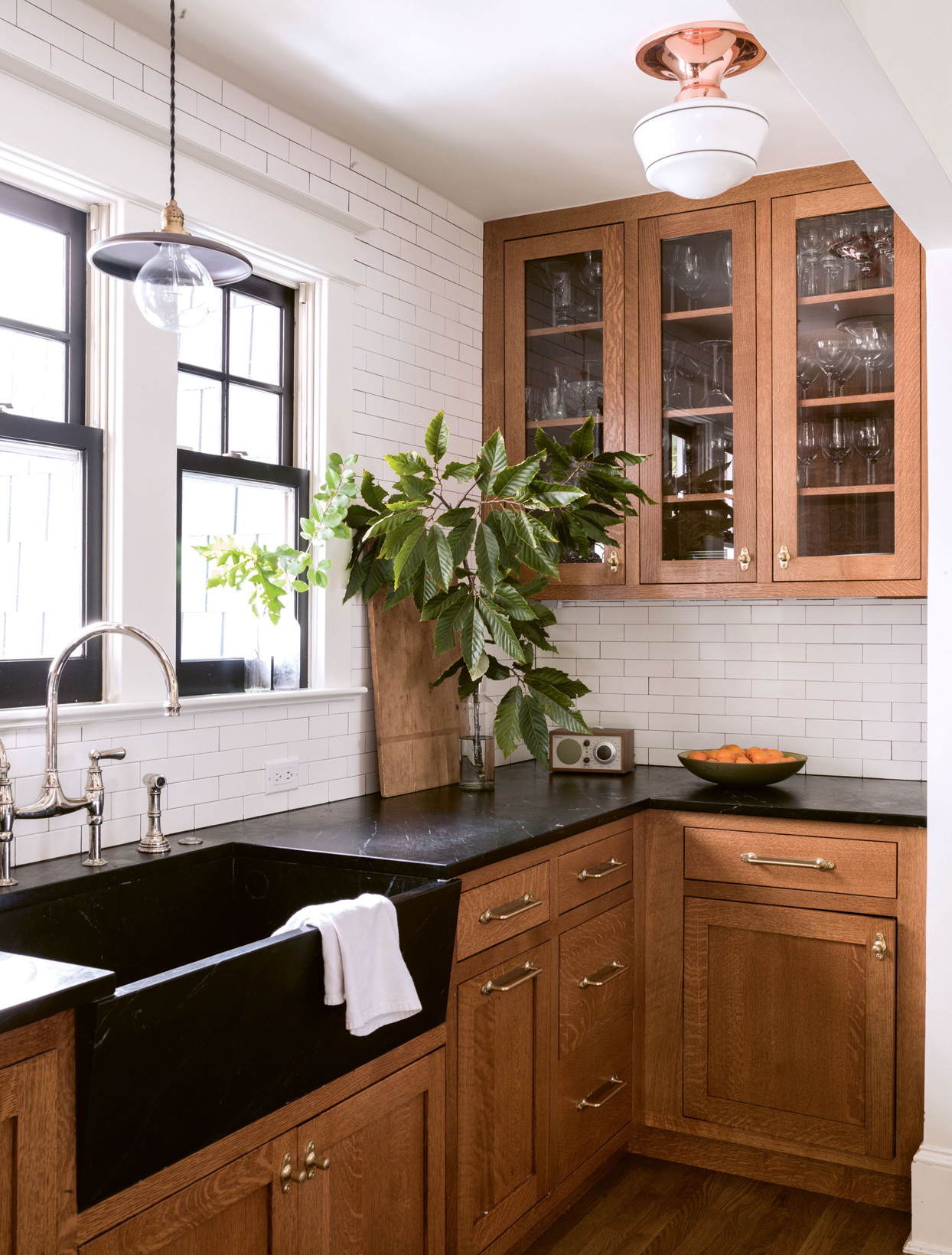 kitchen with white-oak cabinets and deep apron-front sink