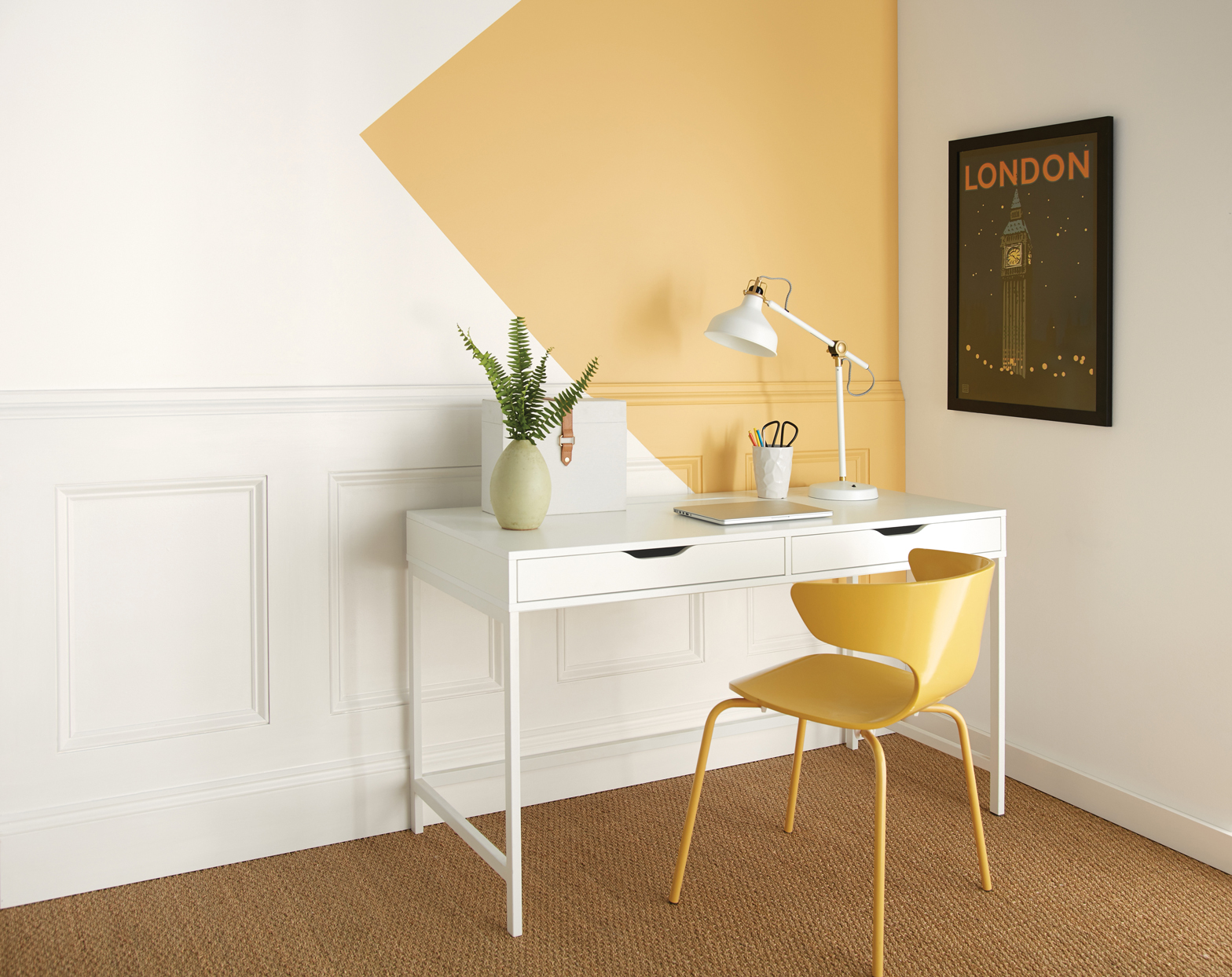 yellow triangle pop of color on wall of at home office