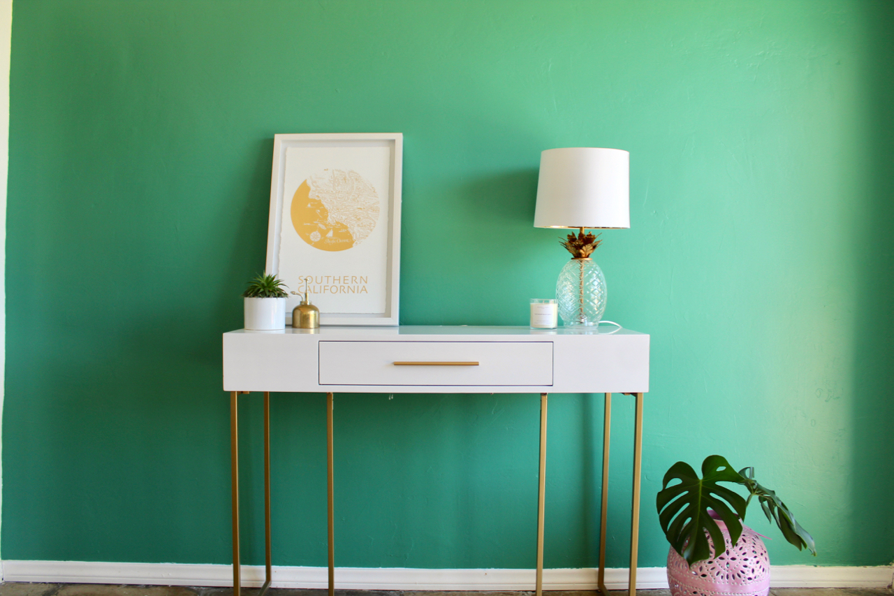 white and gold table in green-painted room