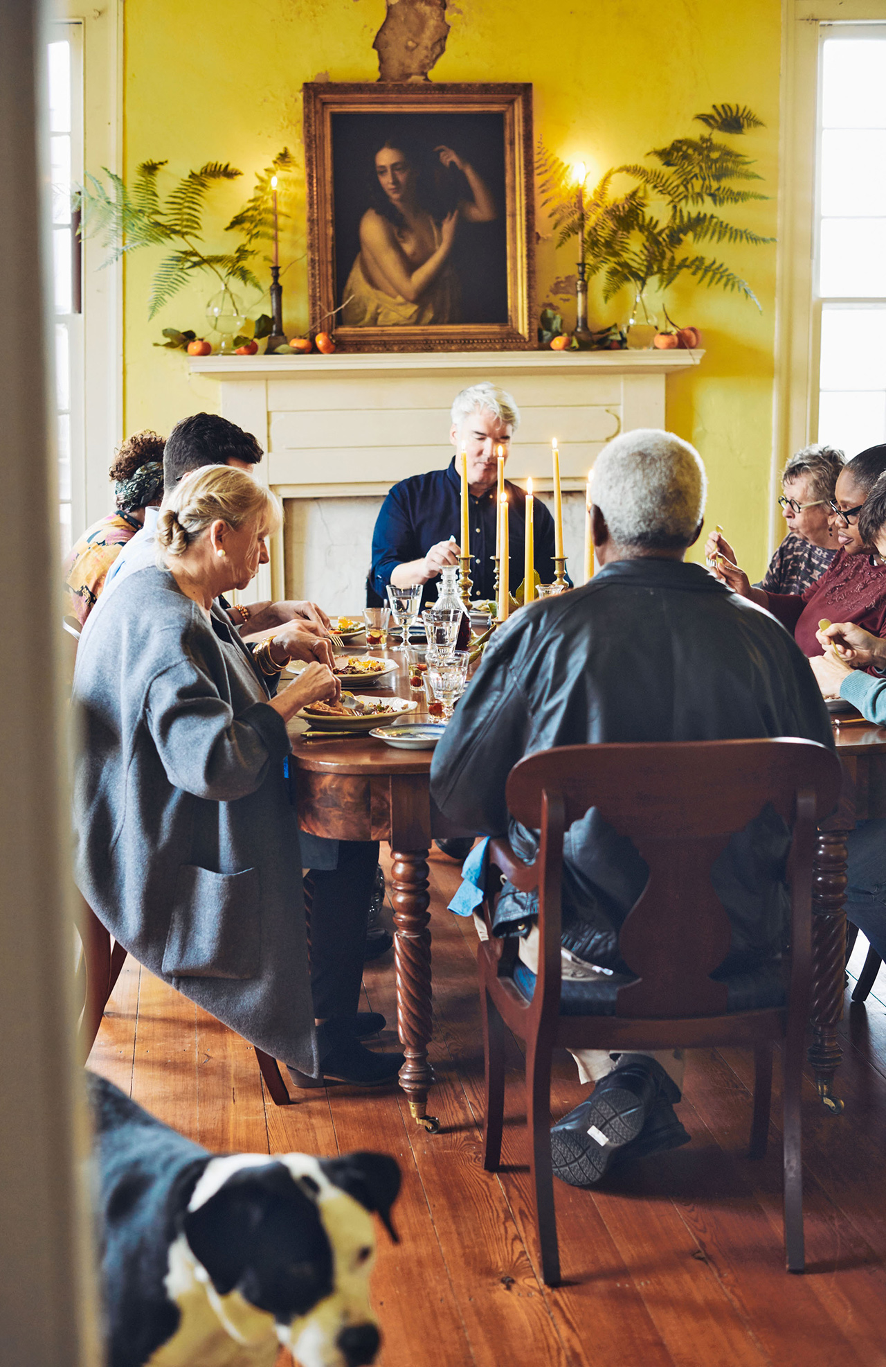 family enjoying thanksgiving dinner in old home