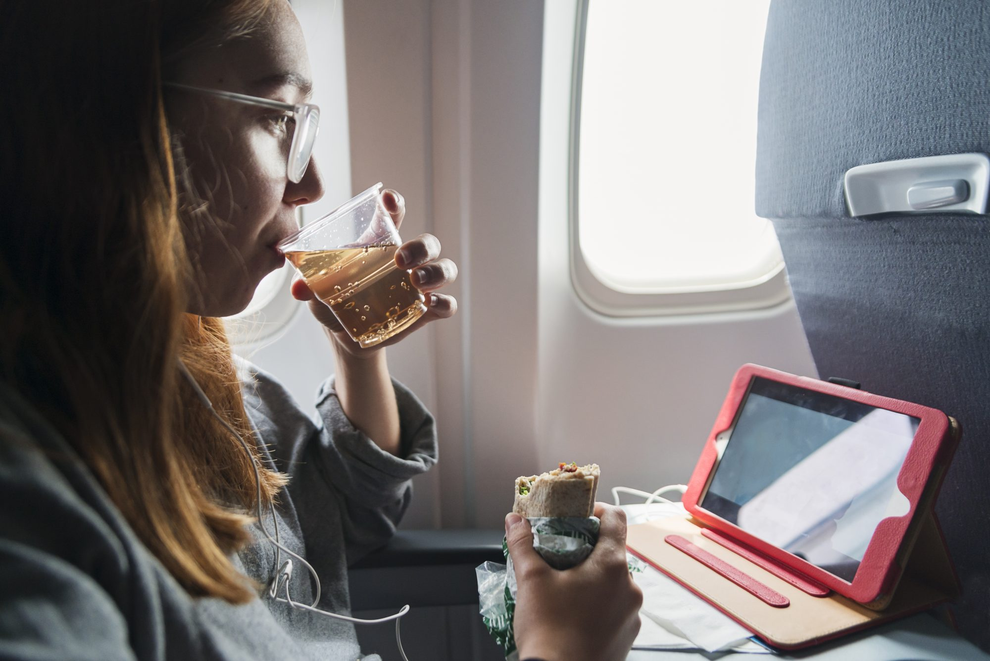 This Is Why You Should Always Order Ginger Ale on a Flight