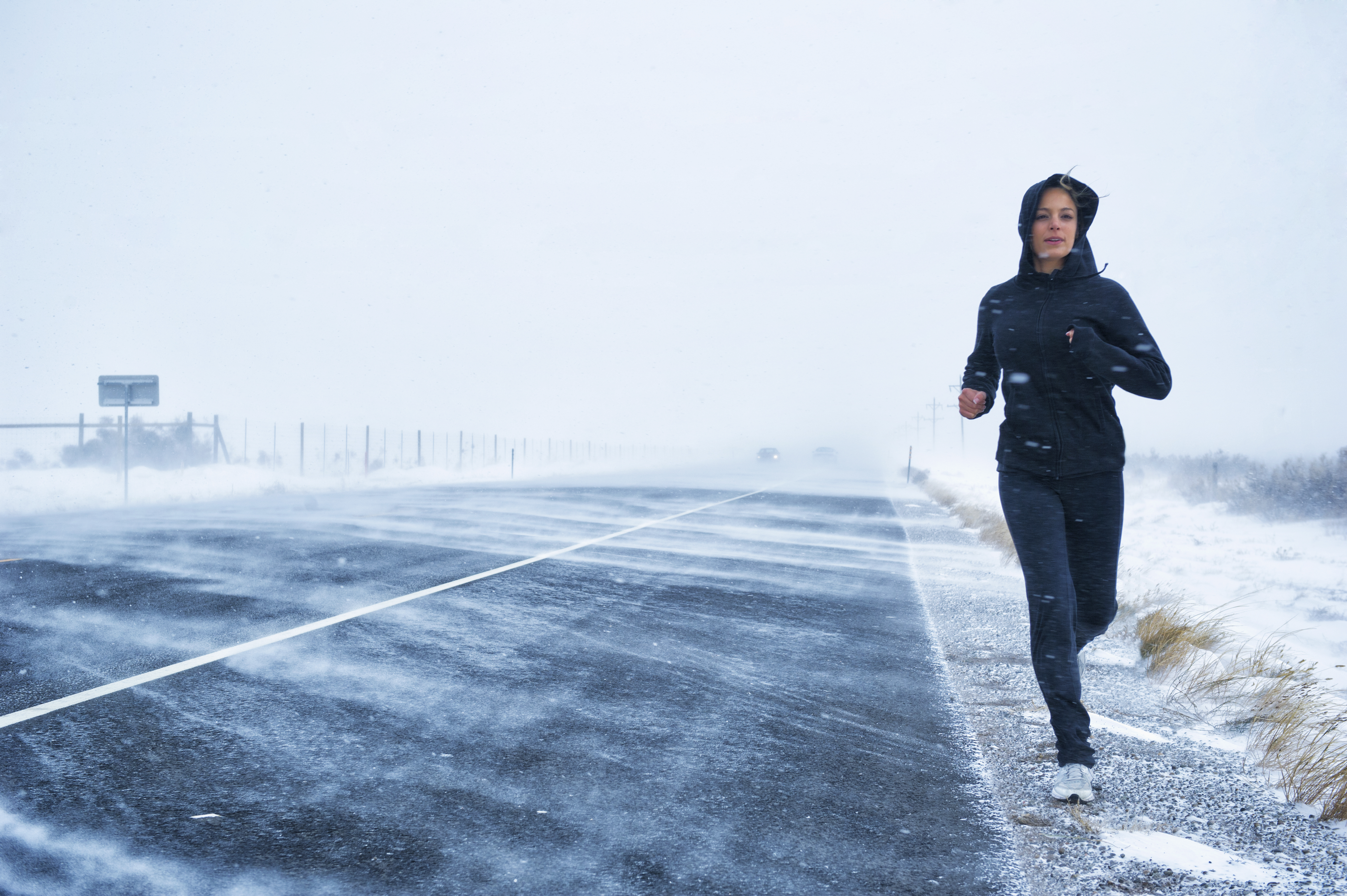 woman running in cold weather winter