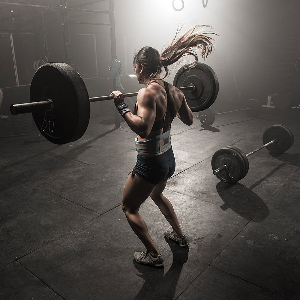 The Intense Workout Playlist That Will Power Your Weight Lifting Sessions