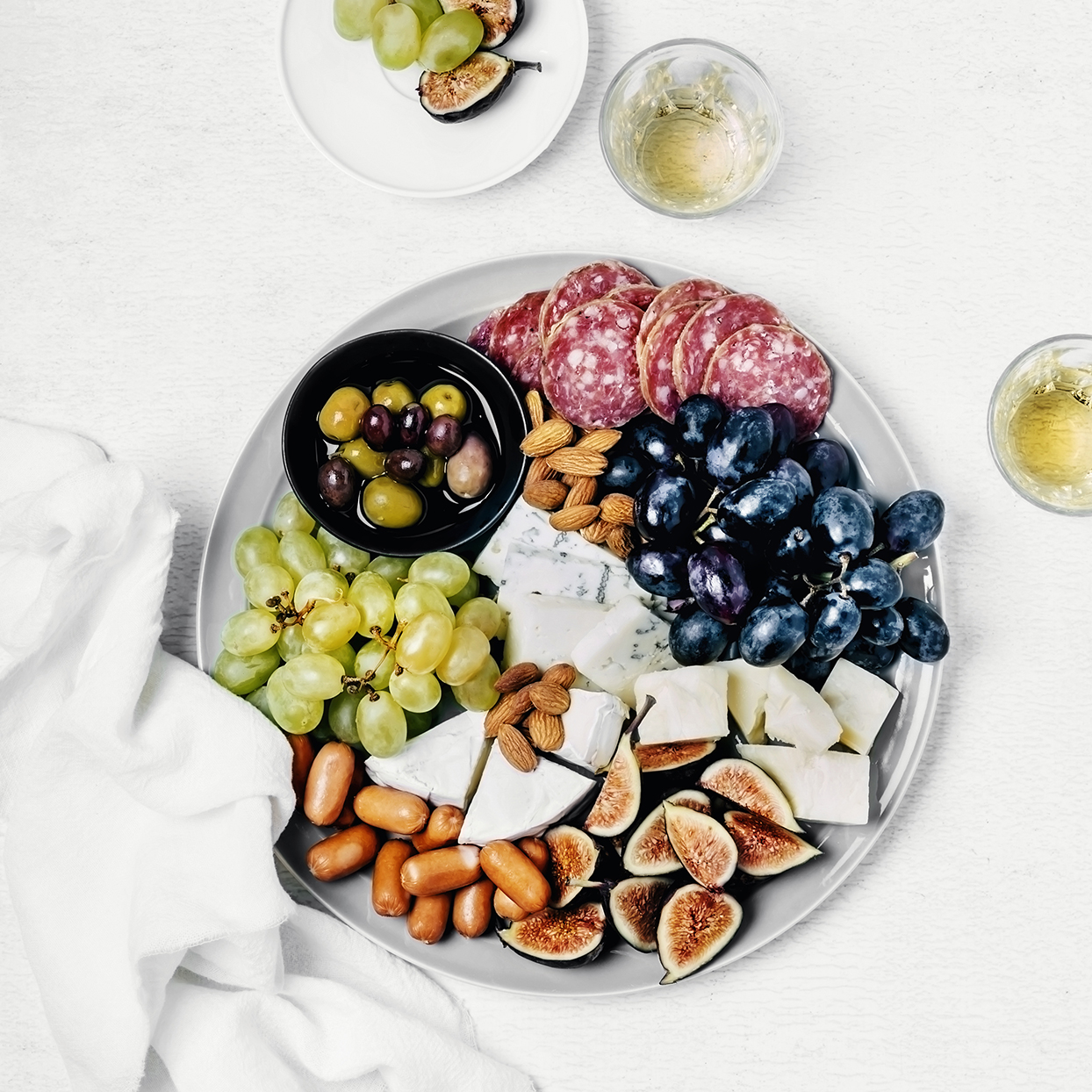 Women should aim for 1,000 milligrams of calcium a day, which is all the more reason to hang out by the cheese platter. One or two sizeable cheddar cheese chunks will give you roughly 120 milligrams, but remember that this healthy party snack can add up quickly in the fat and calorie department. Hard cheeses like cheddar yield more calcium—and more calories—than soft cheeses like brie or goat. For fruit, load up on strawberries, pineapples, or kiwis for an extra wallop of vitamin C and an immunity boost.
