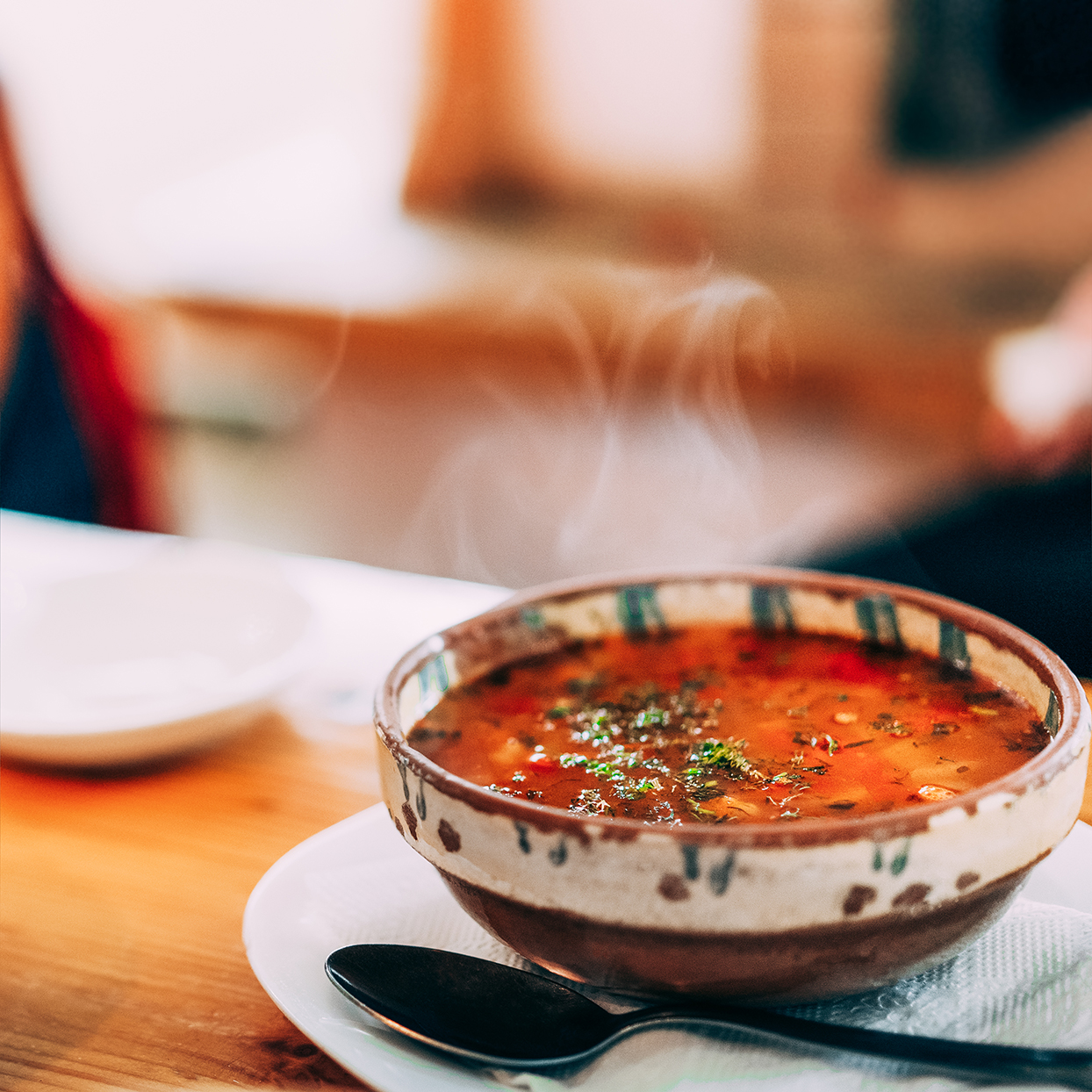 steaming bowl of vegetable soup