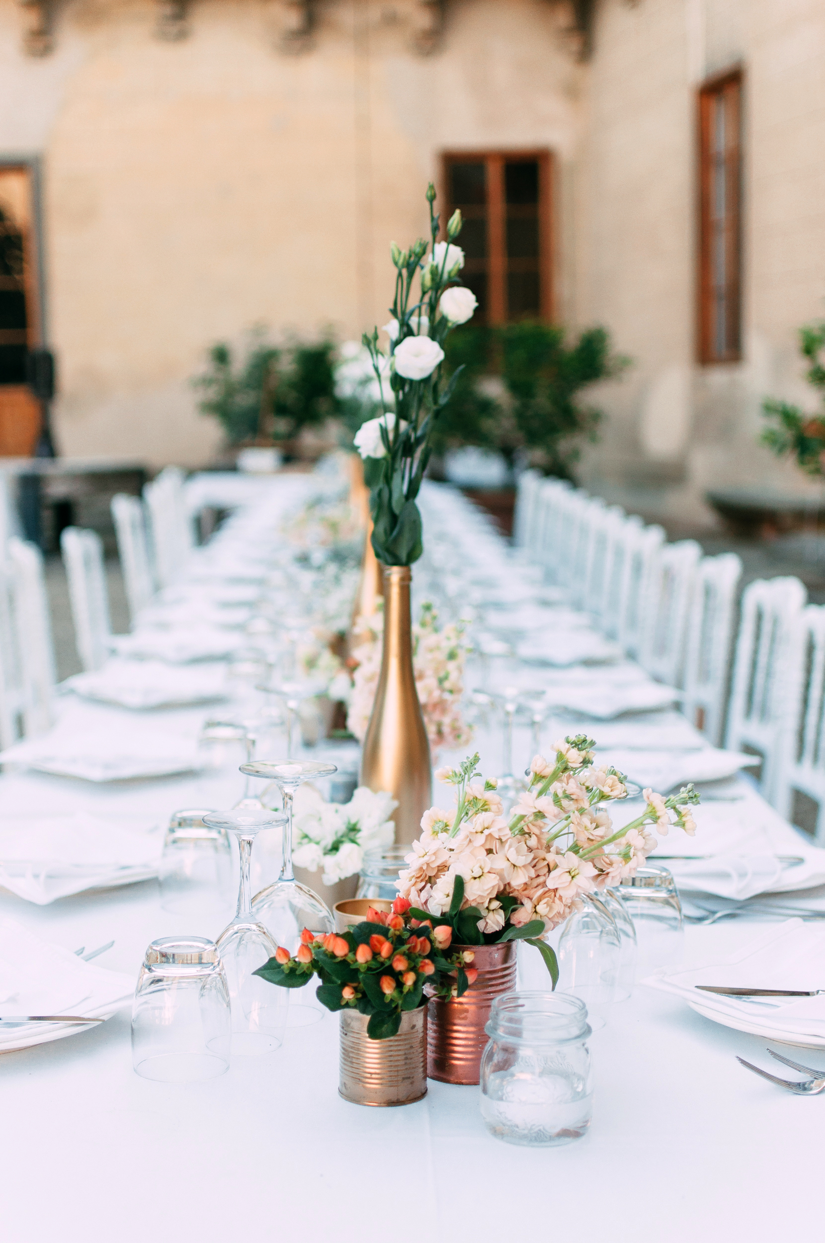wedding centerpieces long table tin cans painted wine bottles