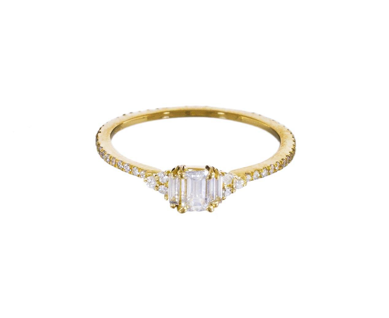 emerald cut ring with gold and diamond band