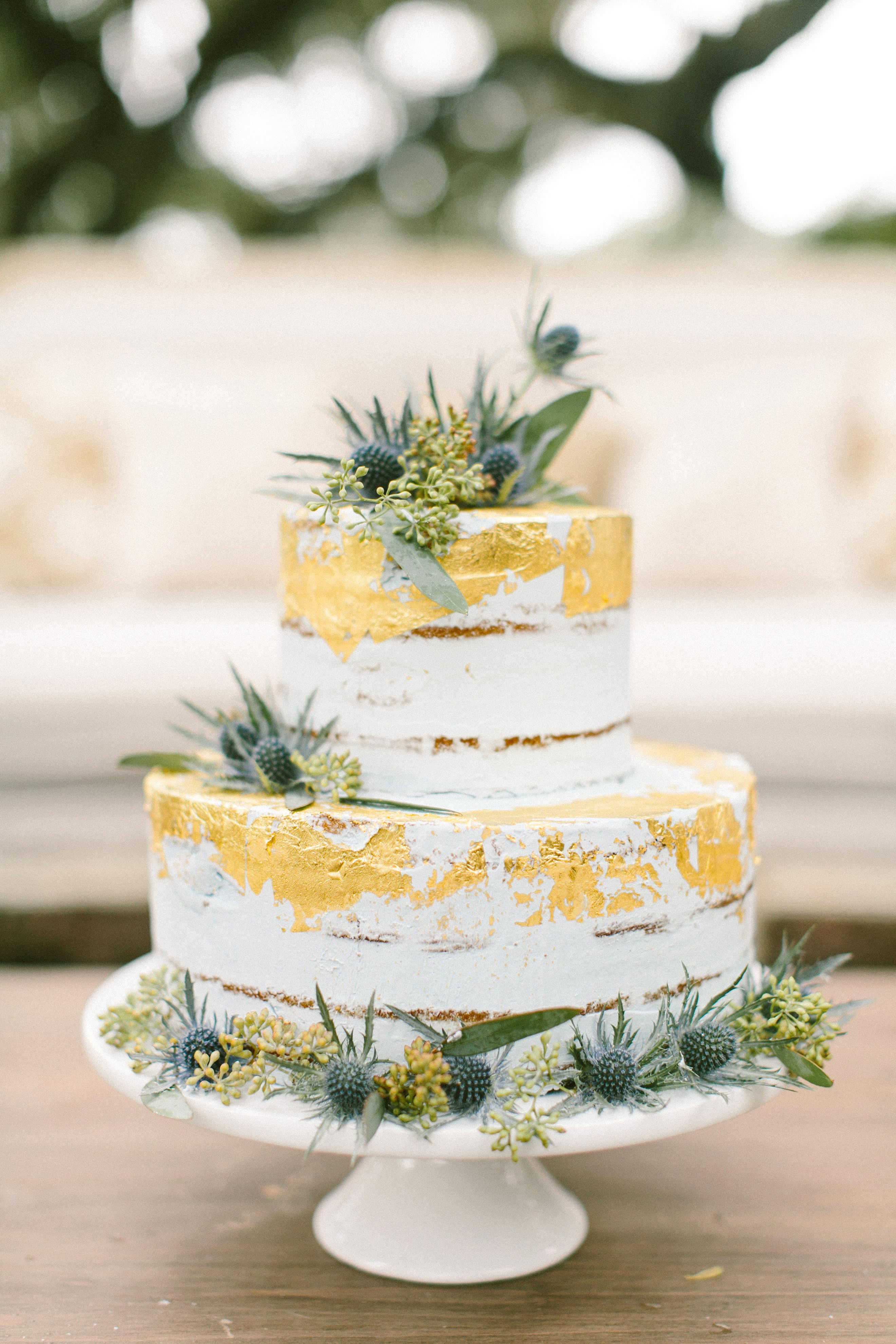 naked wedding cake gold leaf