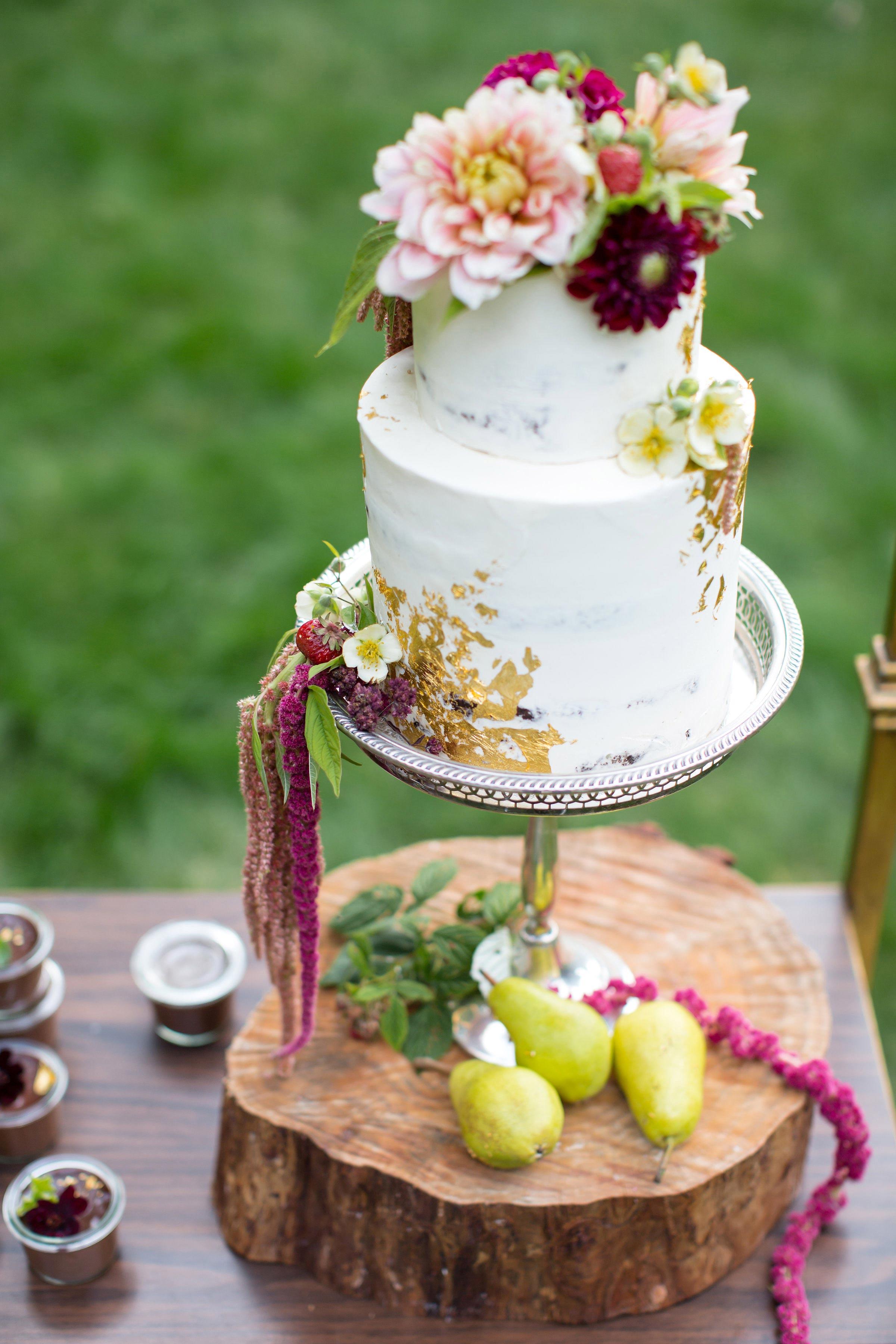 white floral cake gold leaf