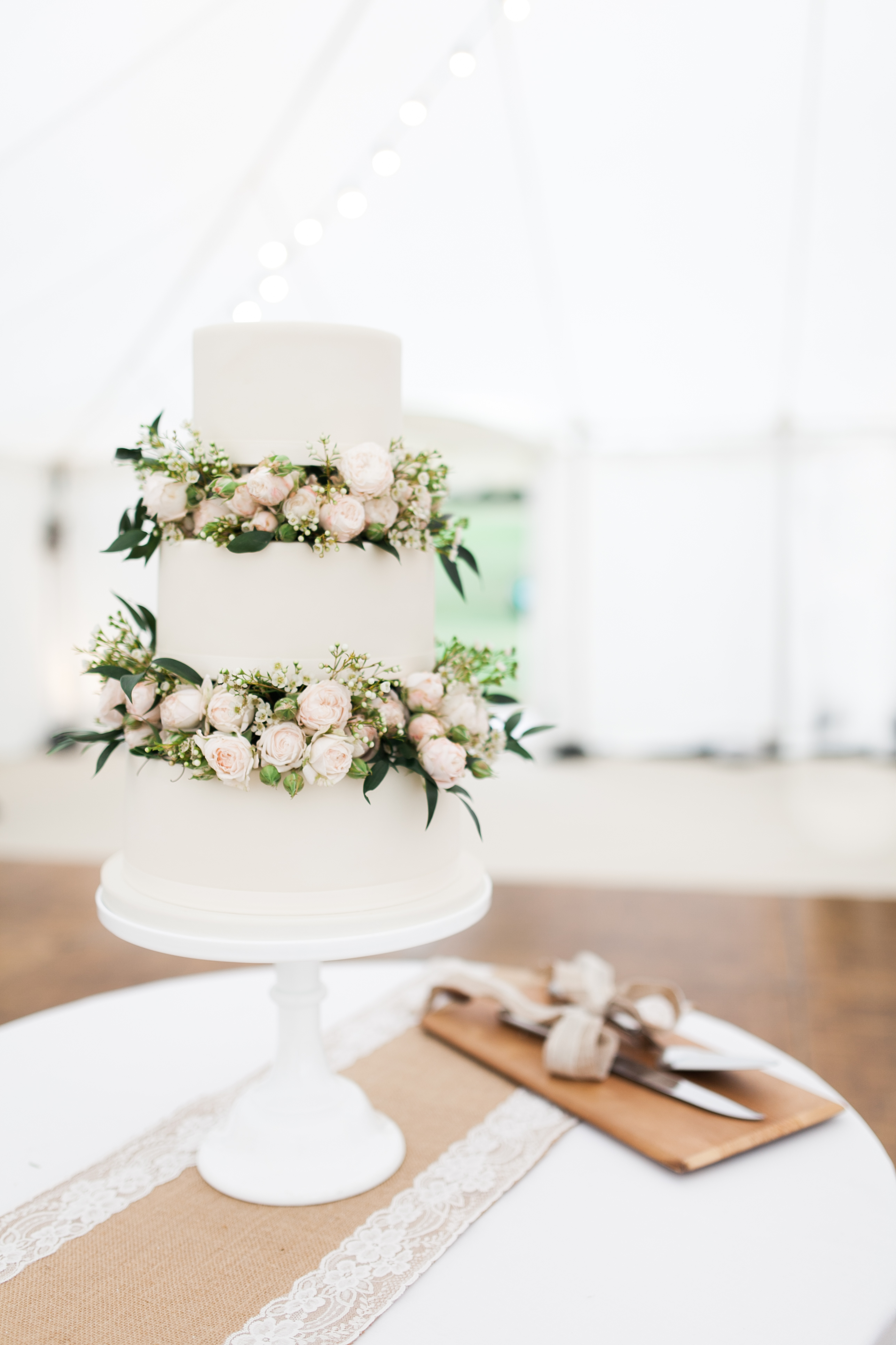 fresh floral wedding cakes with roses in between tiers