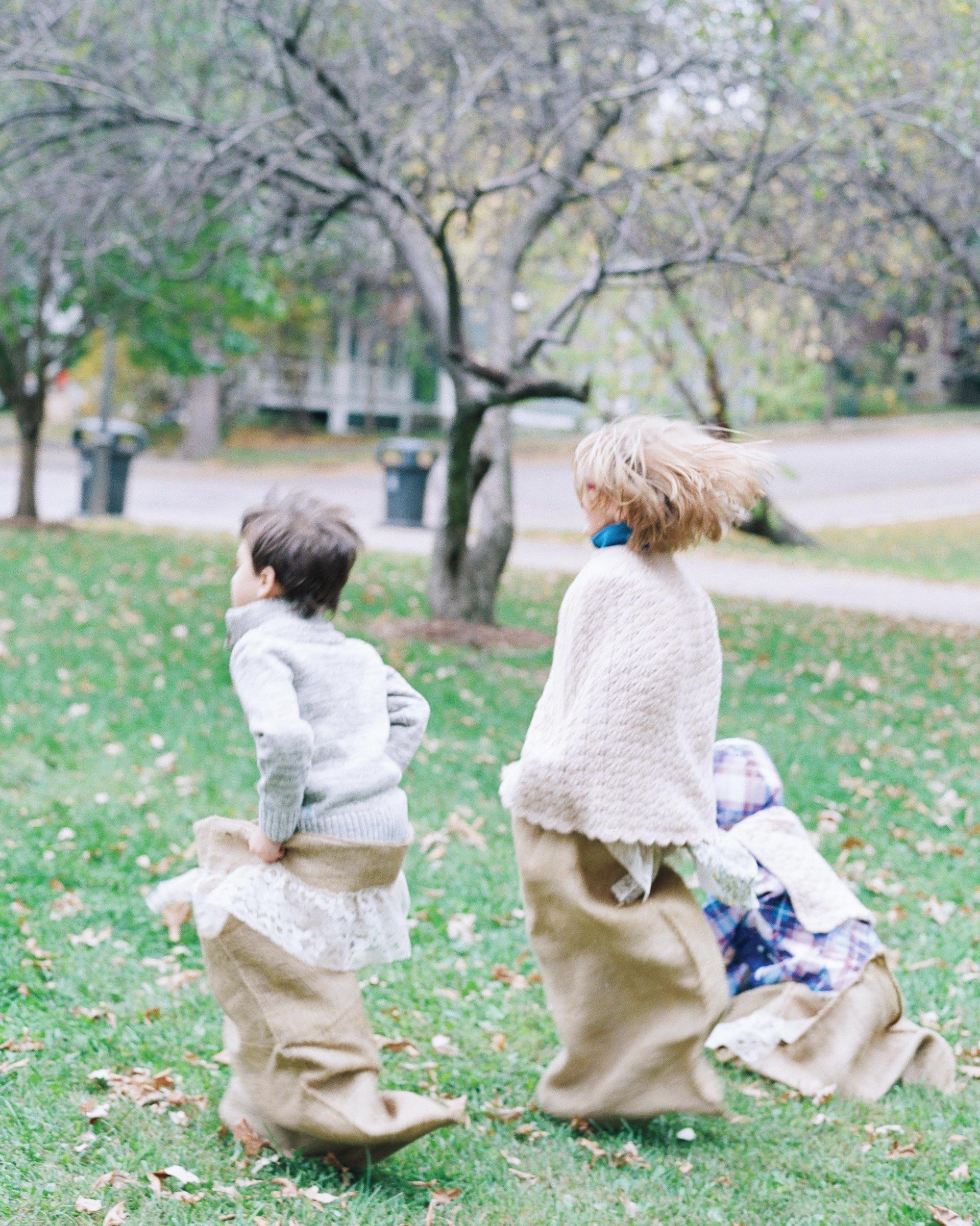 adrienne-jason-real-wedding-kids-bean-bag-racing.jpg