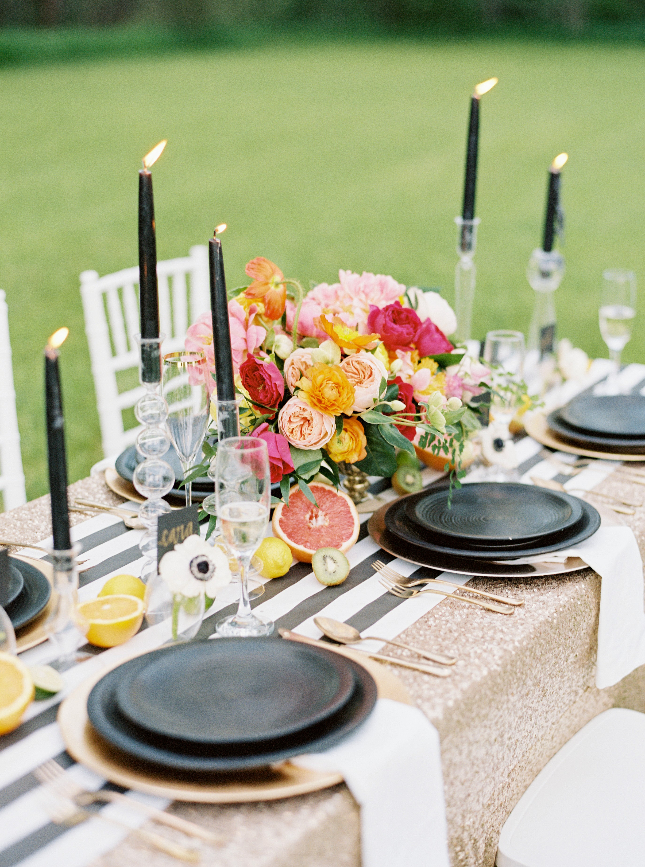 Modern black, white and bright wedding centerpiece