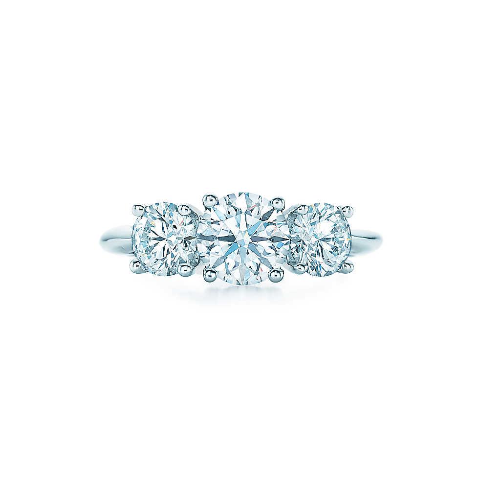round cut ring three white diamonds and a platinum band