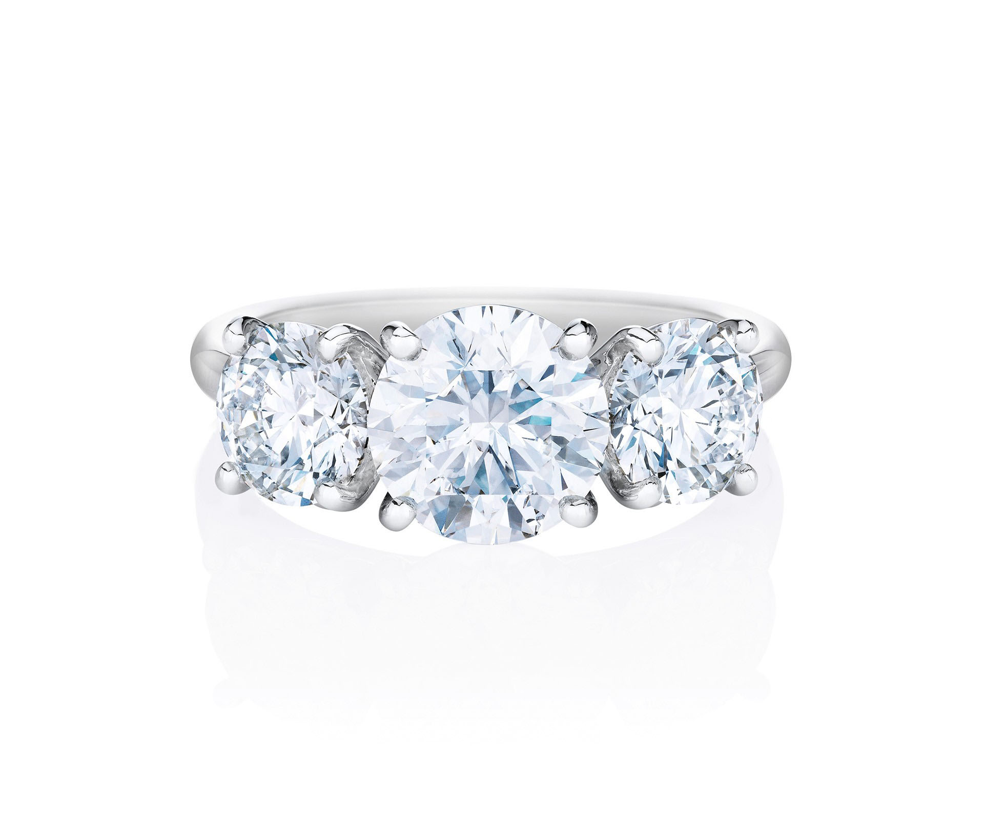 round cut ring three diamonds and a platinum band