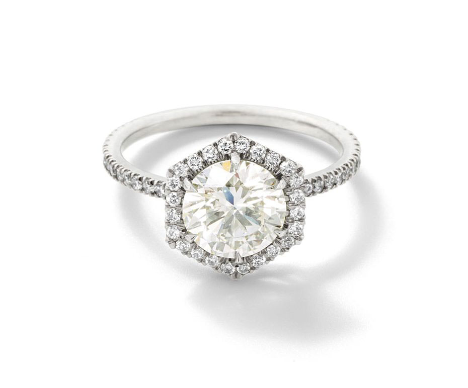 round cut ring platinum band with white diamond detailing
