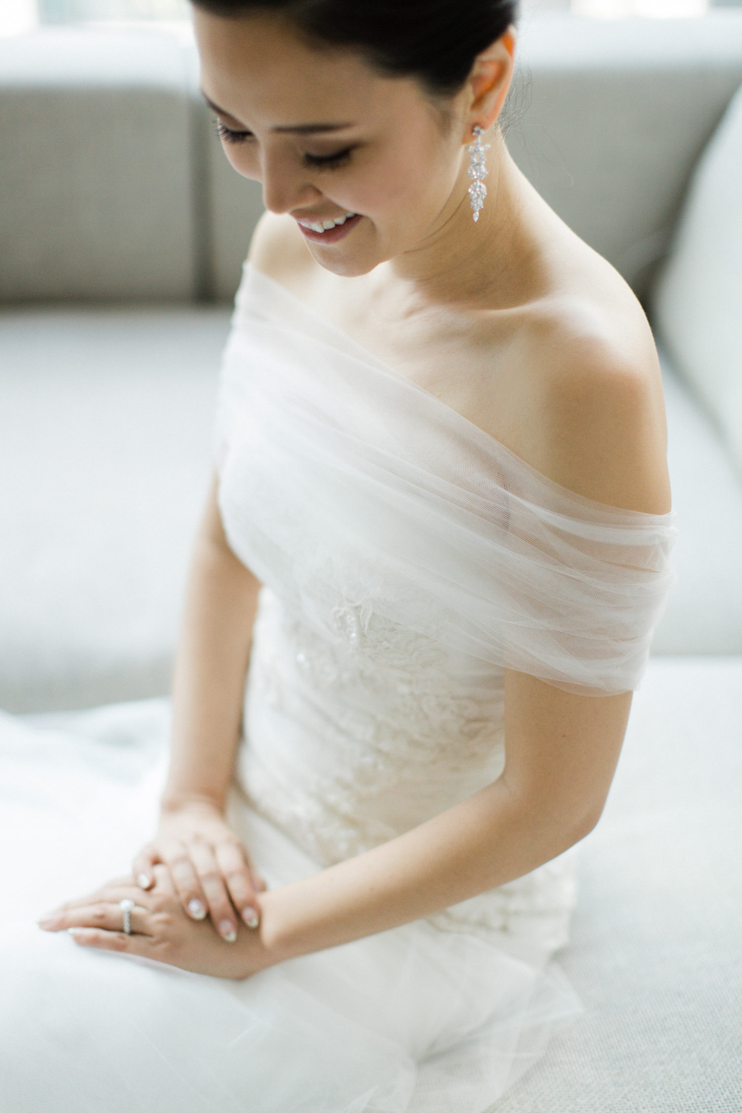 bride wearing long earrings
