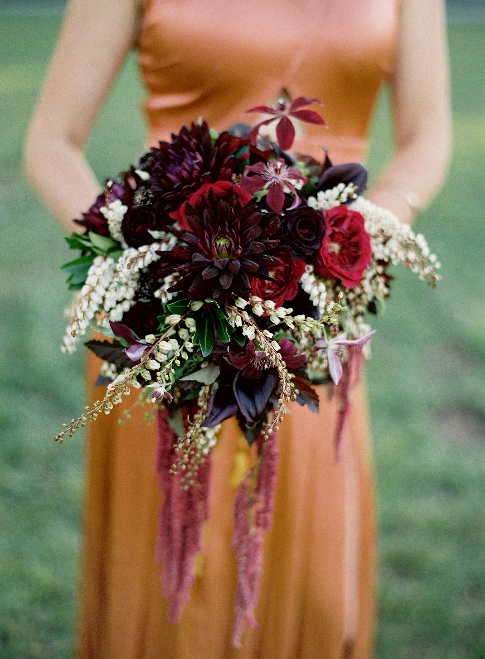 bouquet with red dahlias and calla lilies