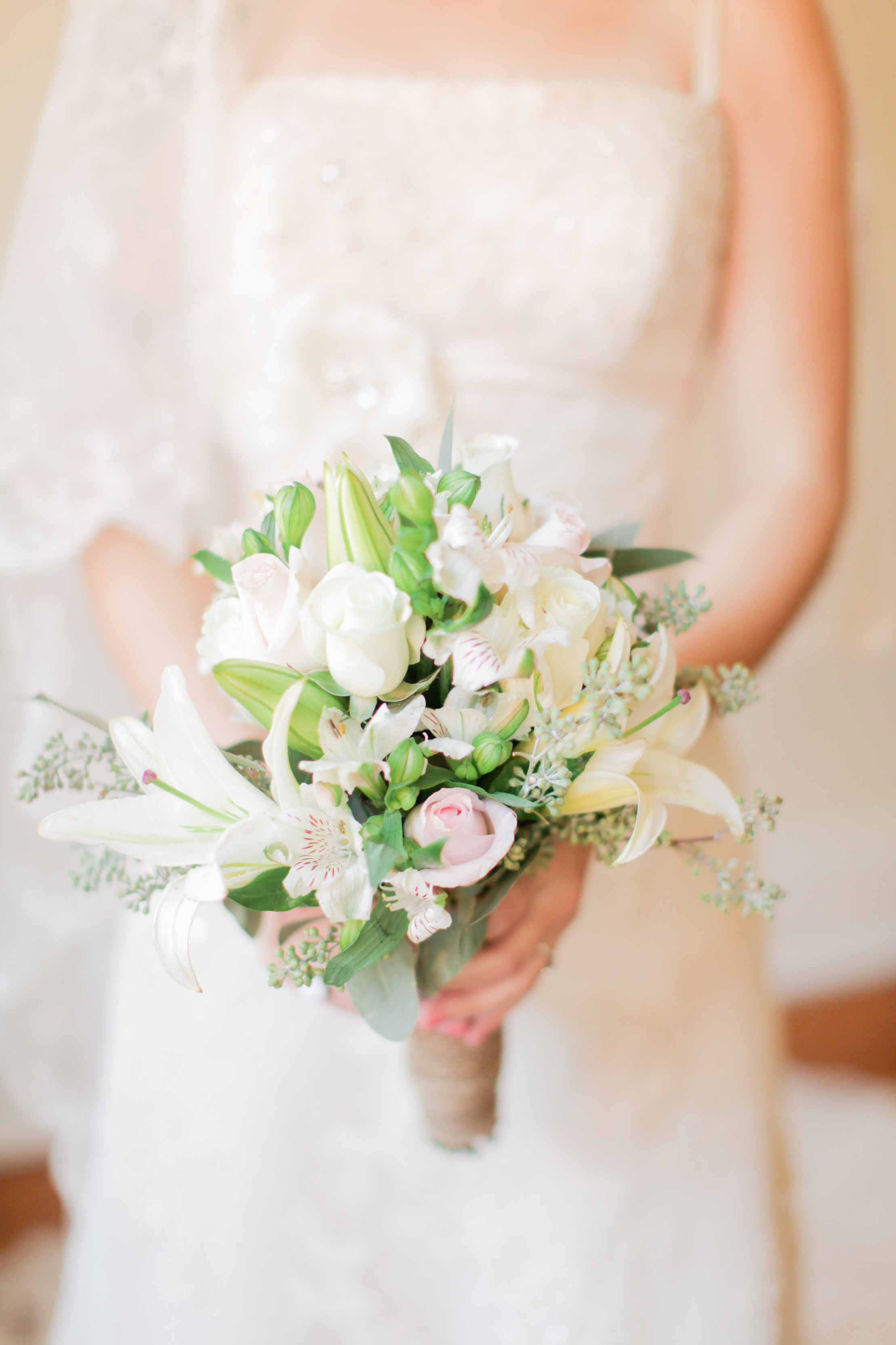bouquet with lilies seeded eucalyptus and garden roses