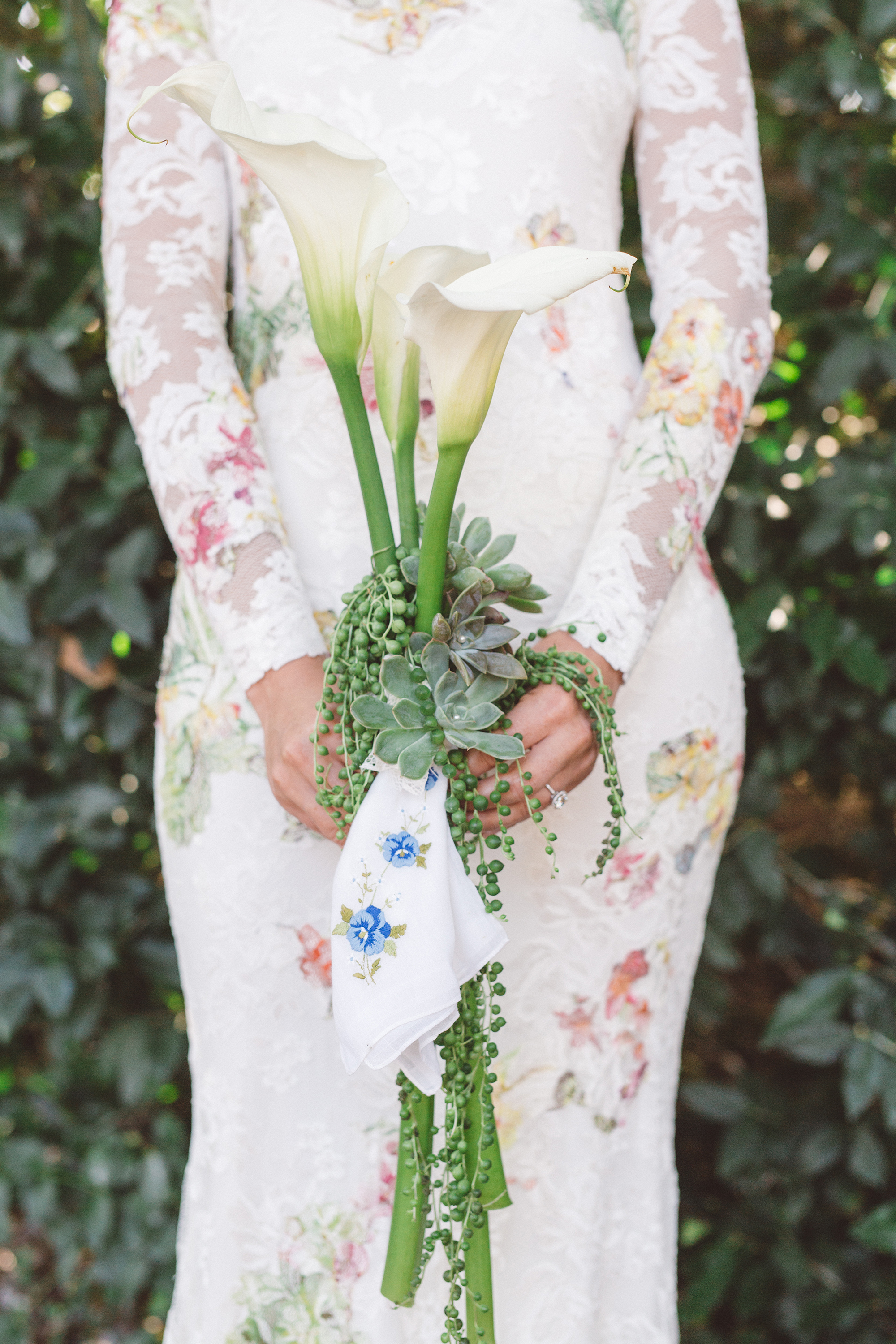 bouquet with three calla lilies and succulents