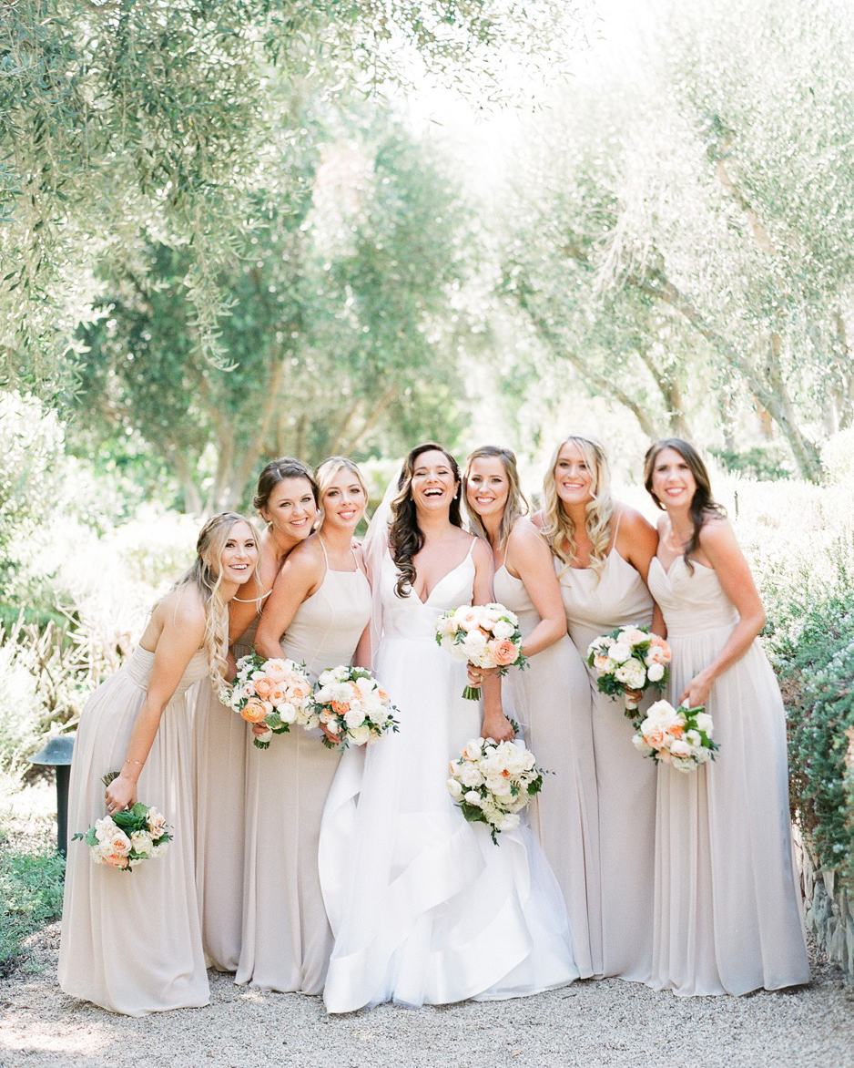 bridesmaids wearing beige colored gowns