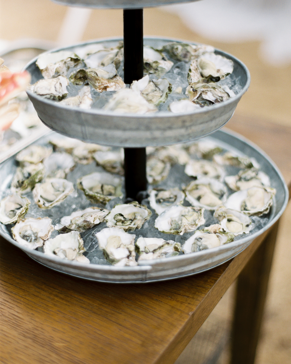 oysters presented on three-tier serving tray