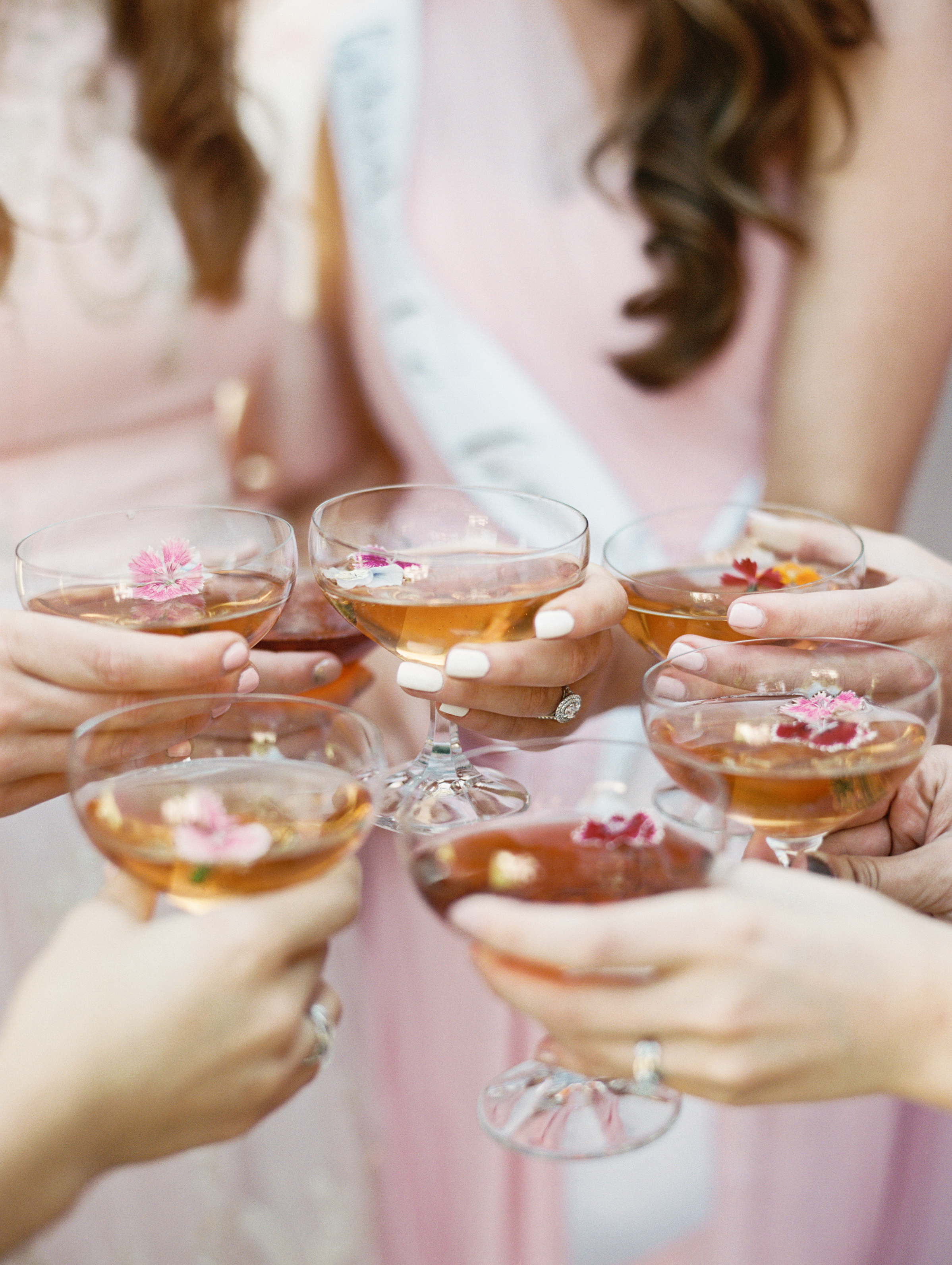 women toasting with cocktails