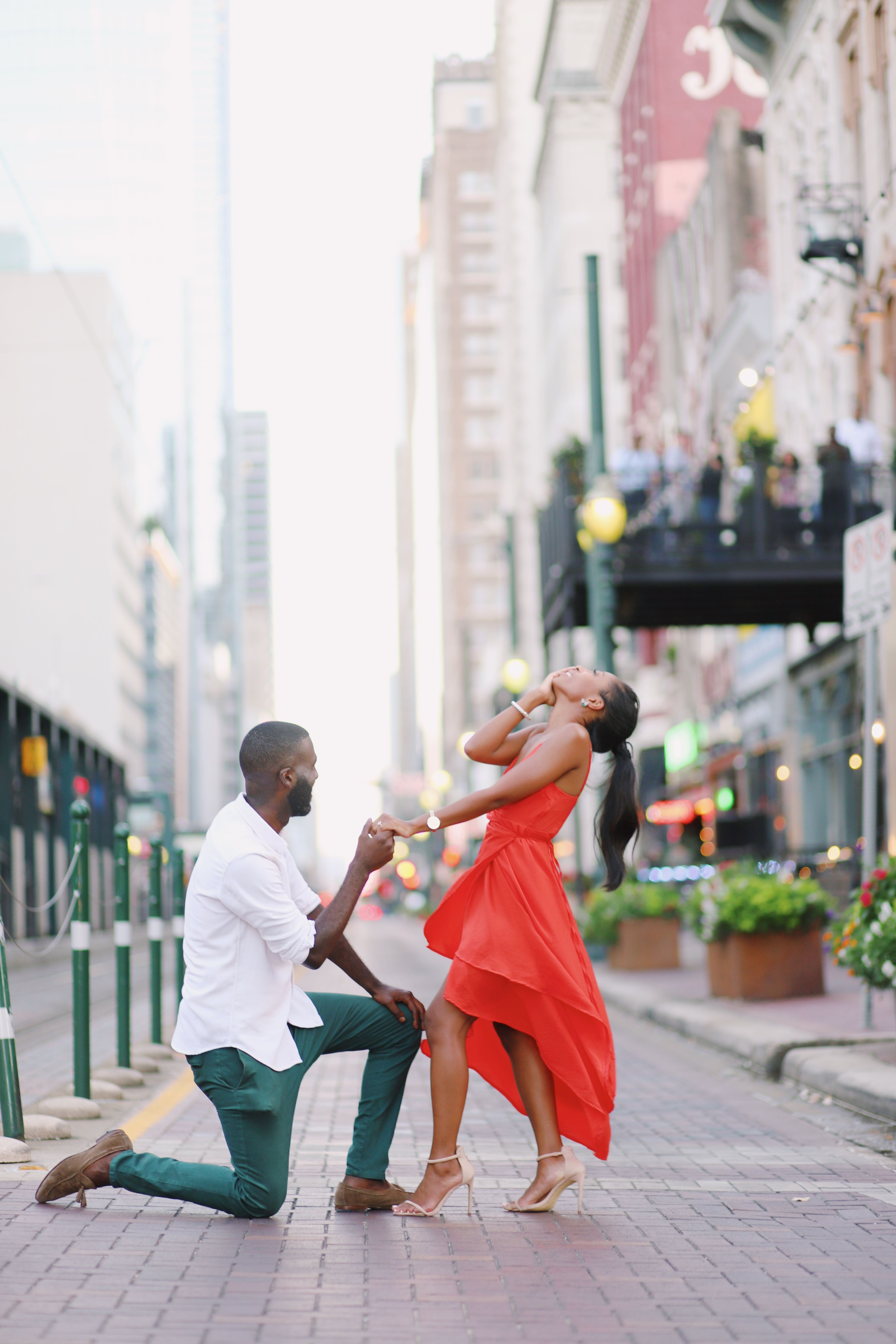 perfect proposals man proposing to girl in red dress