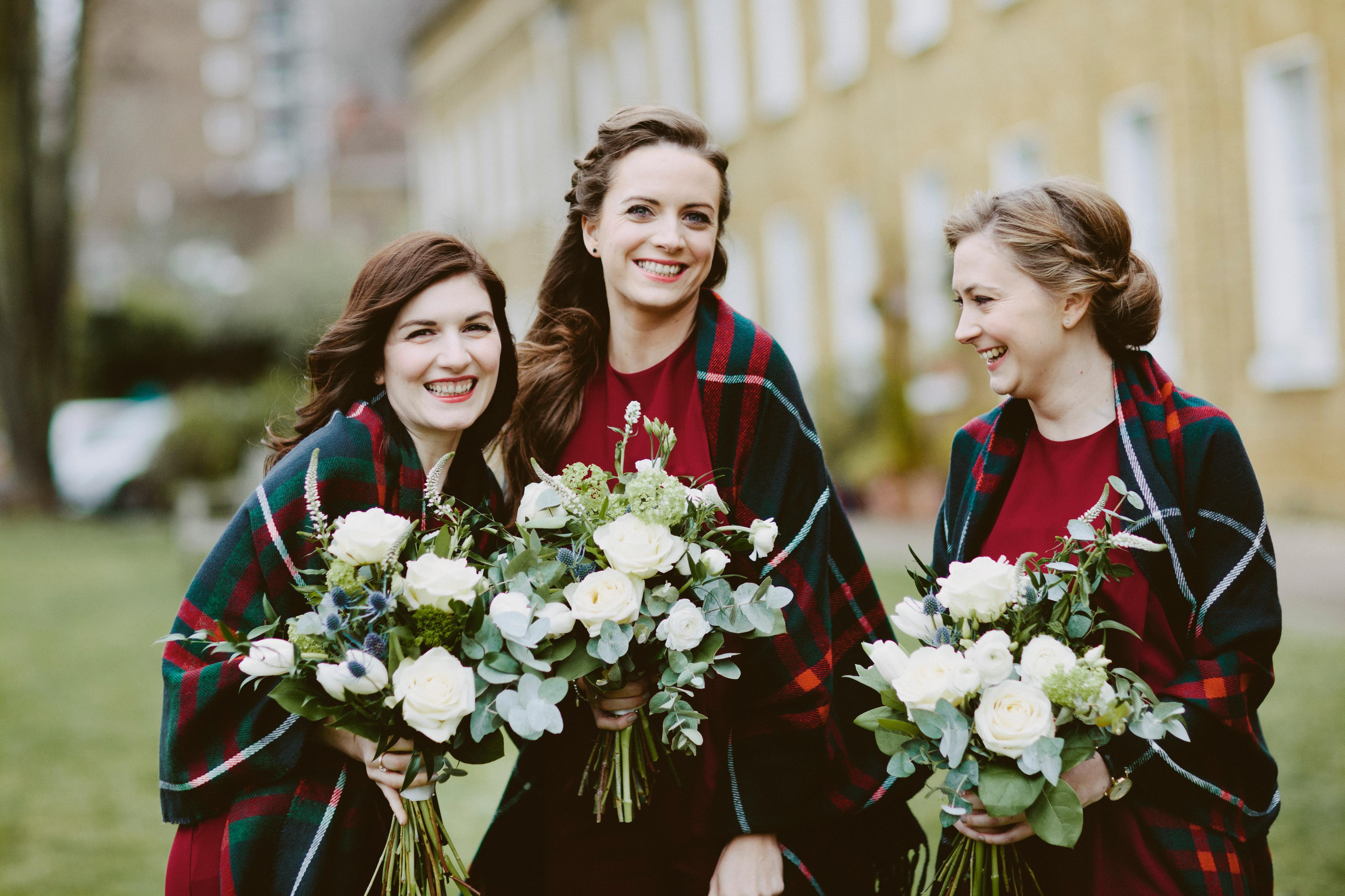 bridesmaids wearing plaid blankets