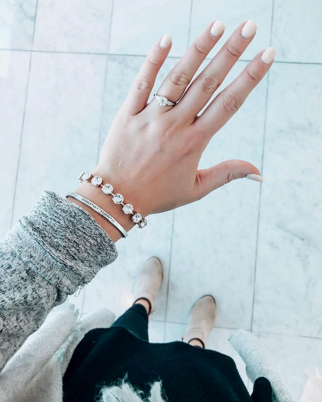 engagement ring selfie marble floor