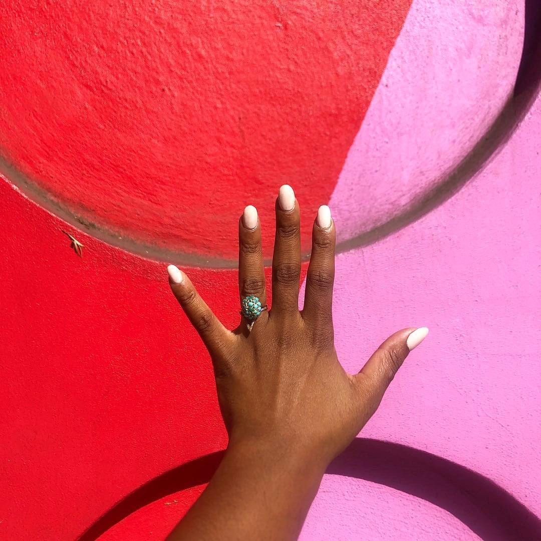 engagement ring selfie red and pink mural
