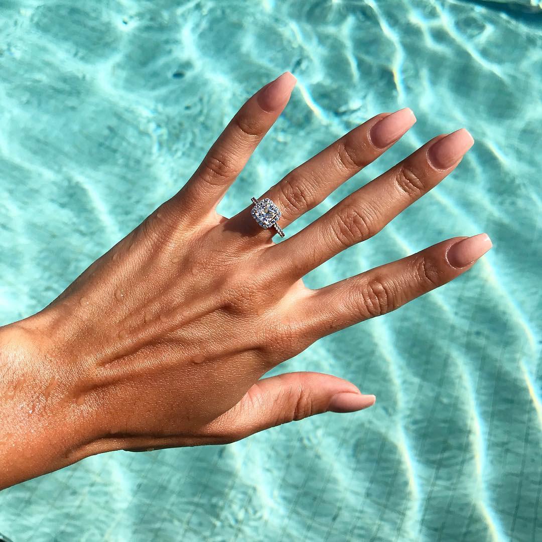 engagement ring selfie swimming pool
