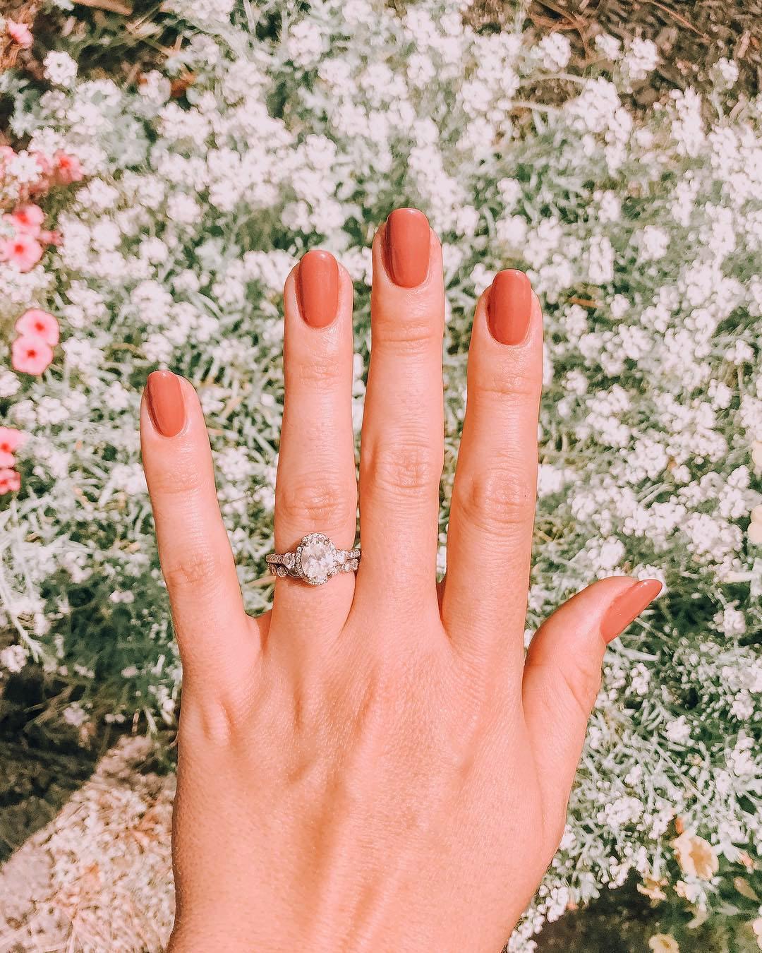 engagement ring selfie flower garden