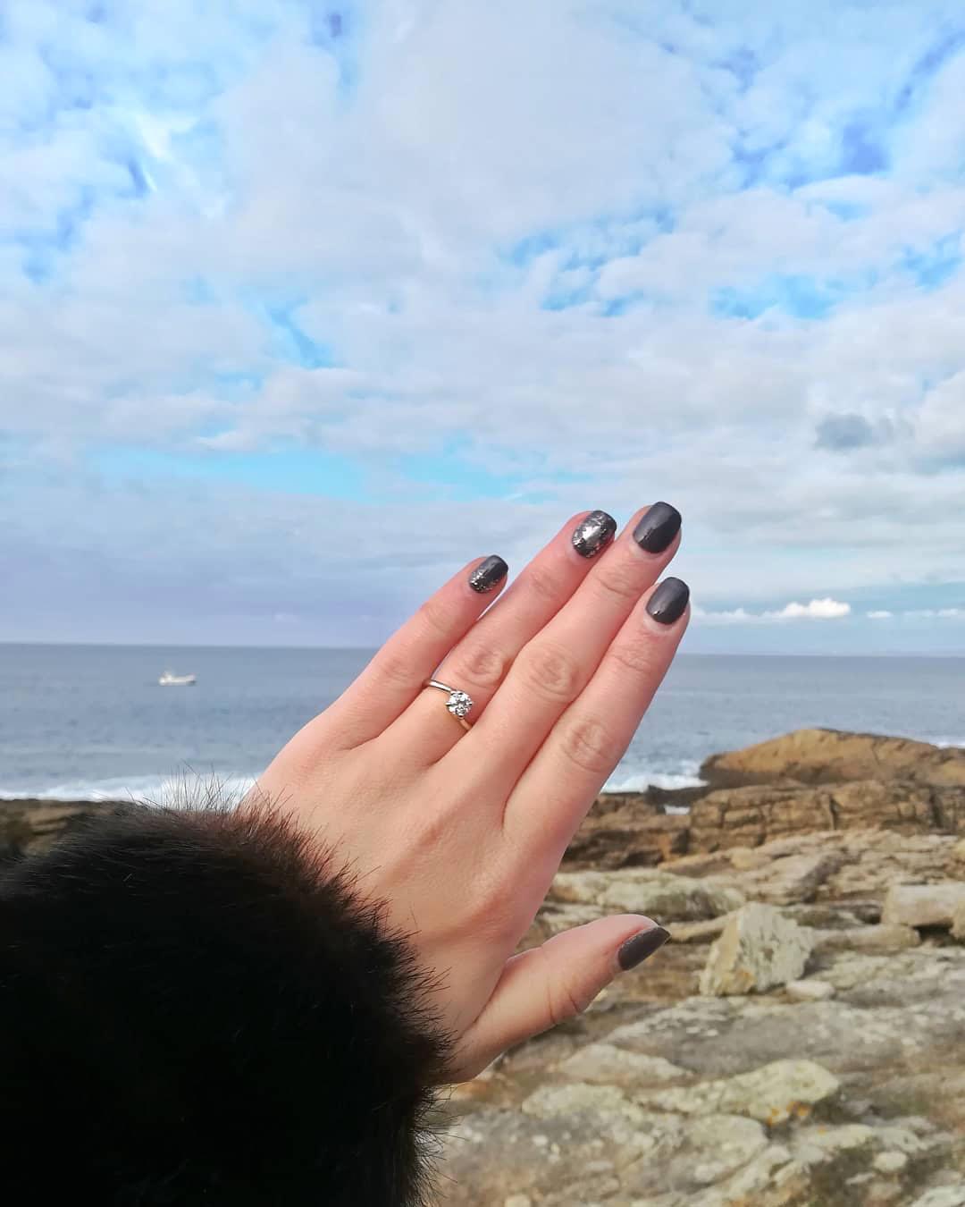 engagement ring selfie rocky ocean view