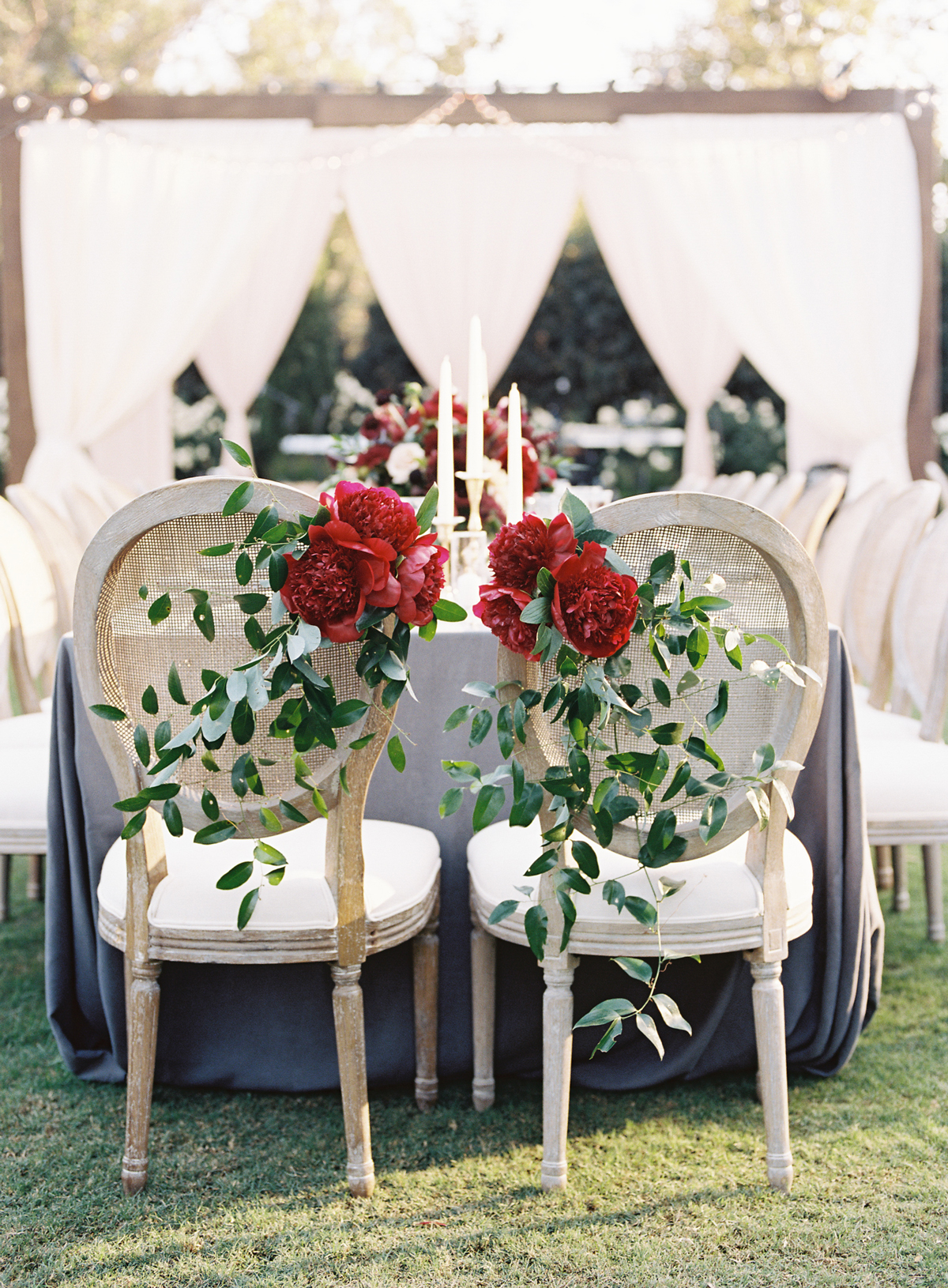 crimson peonies on the back of chairs