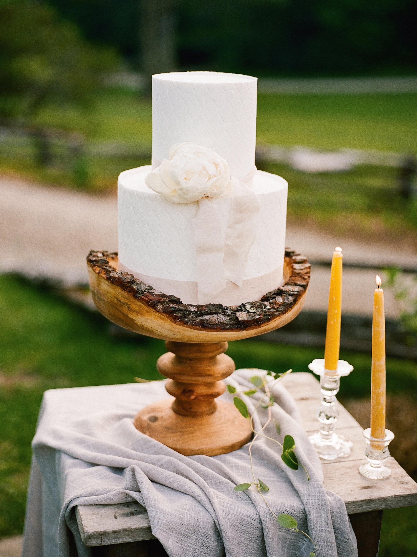 ribbon cake on wood serving dish
