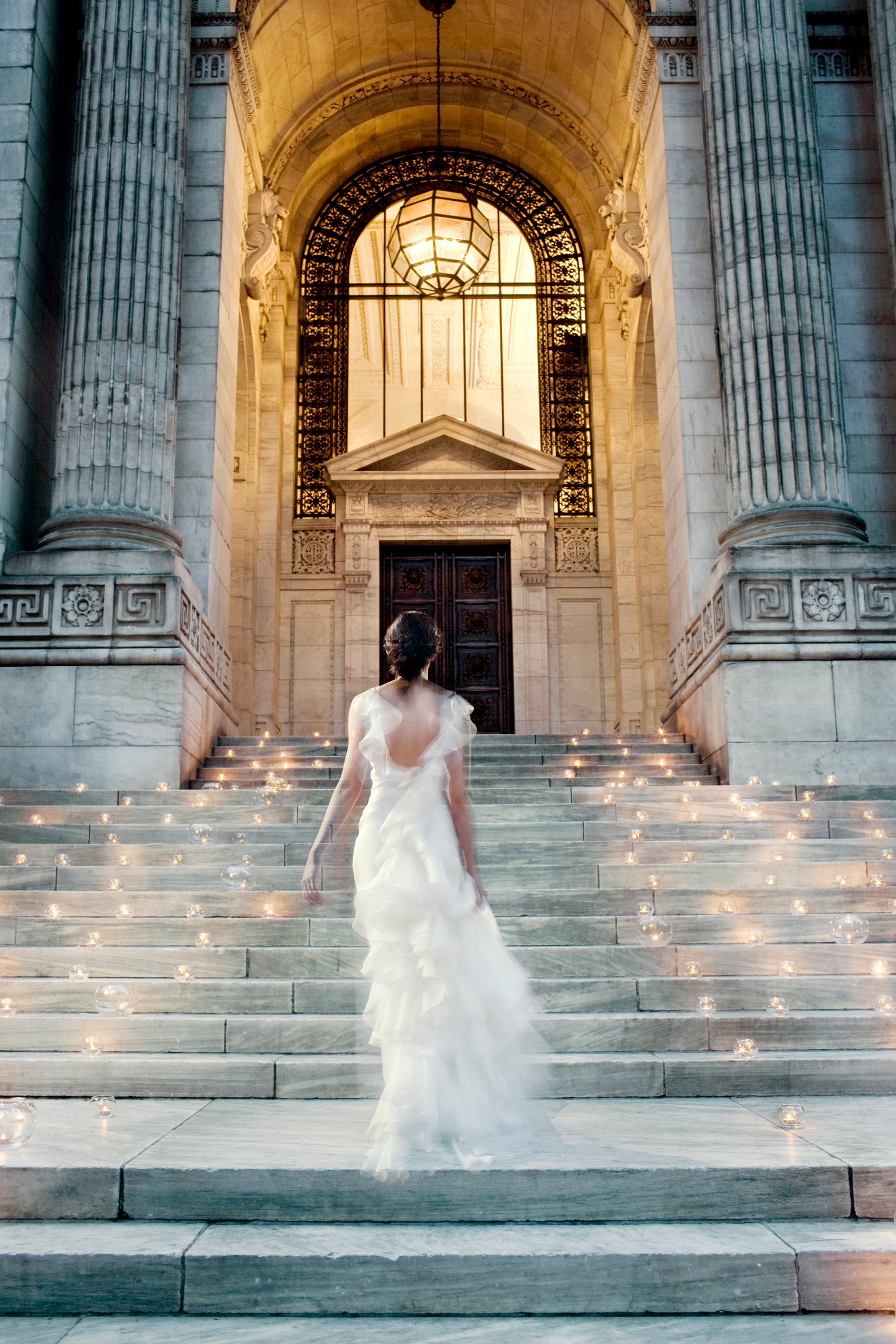 bride walking up new york public library steps