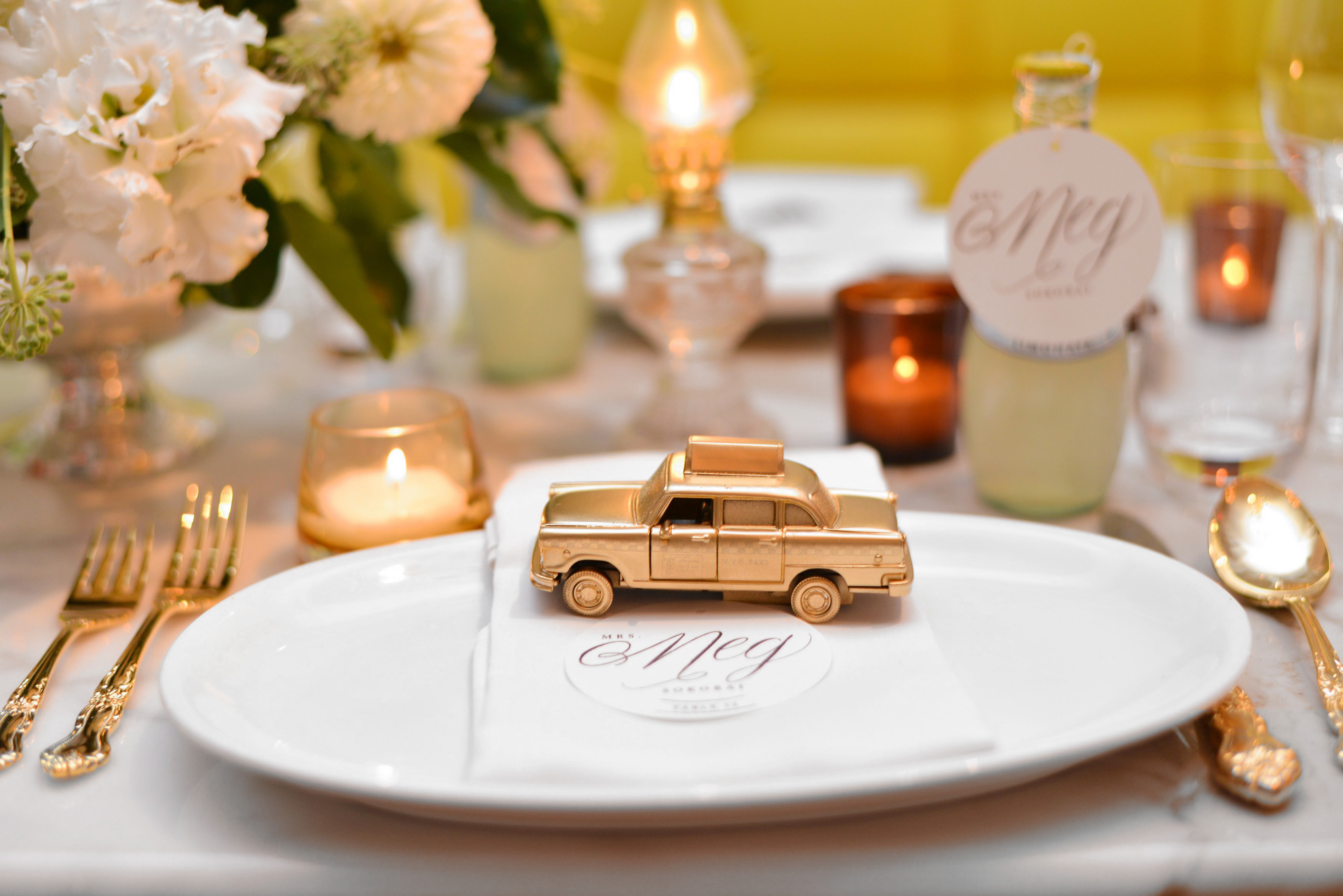 mini taxi cab on place setting
