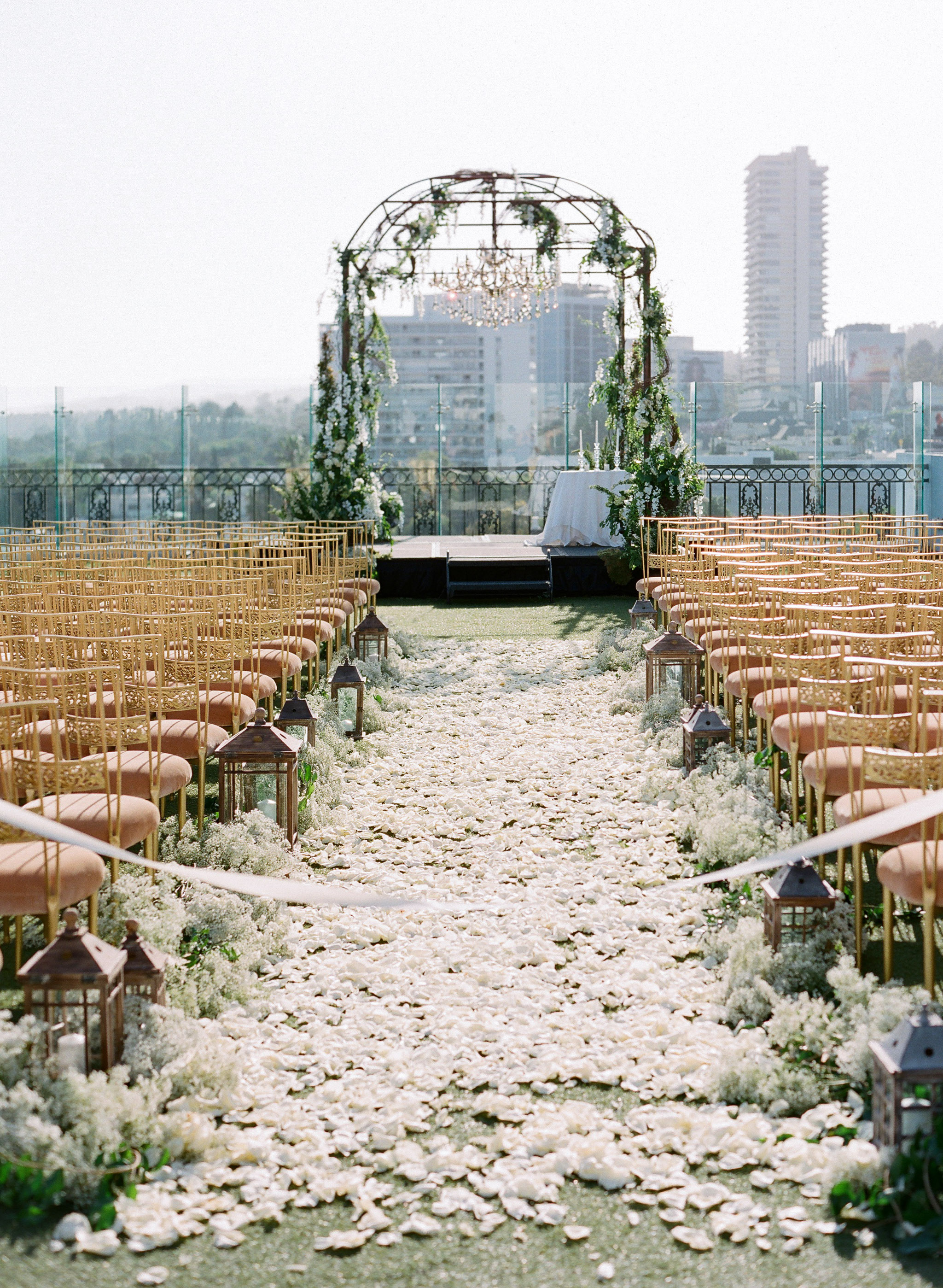 wedding chandelier outdoor ceremony structure with greenery