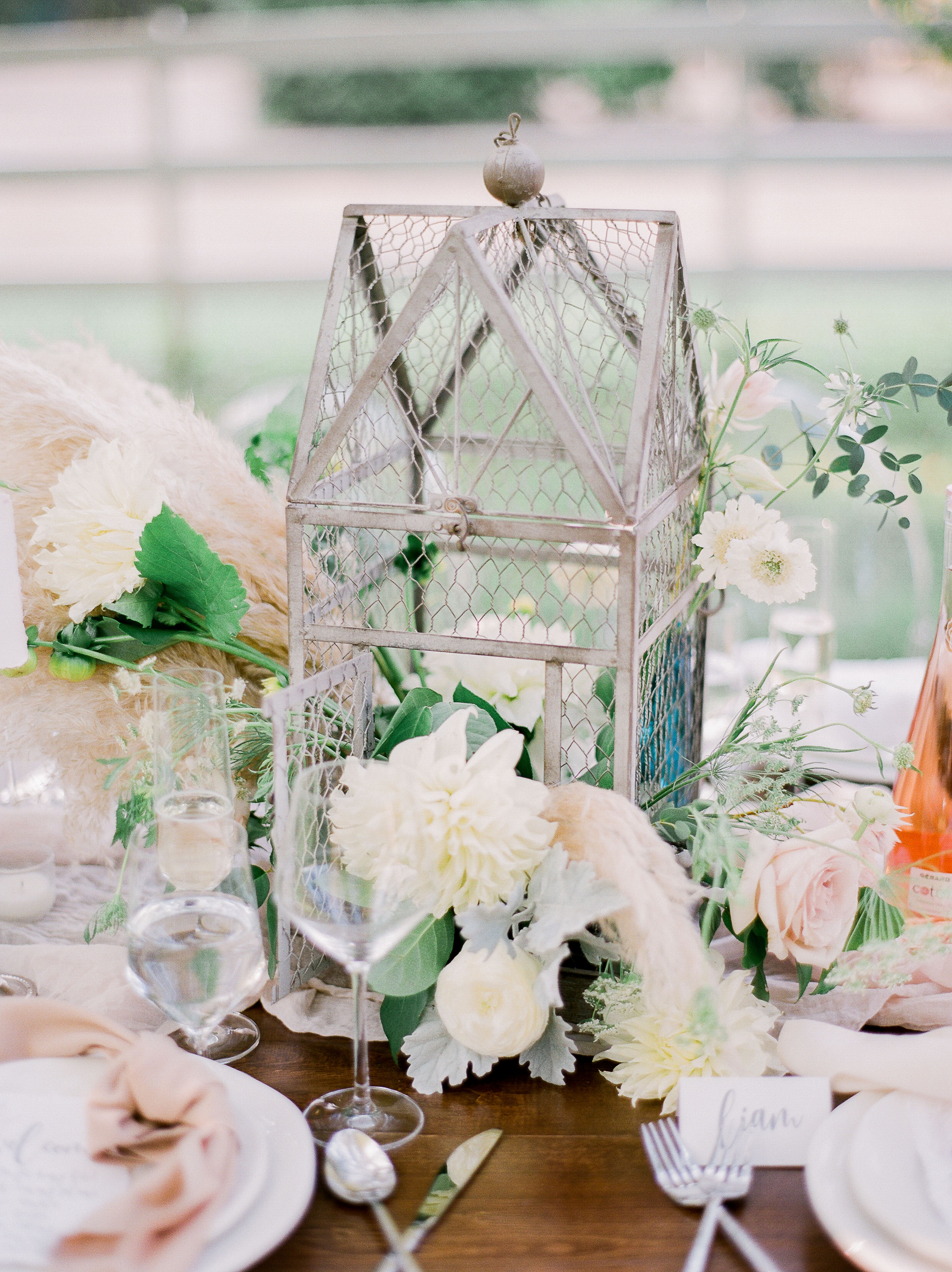 dahlia wedding centerpieces whimsical birdcage arrangement