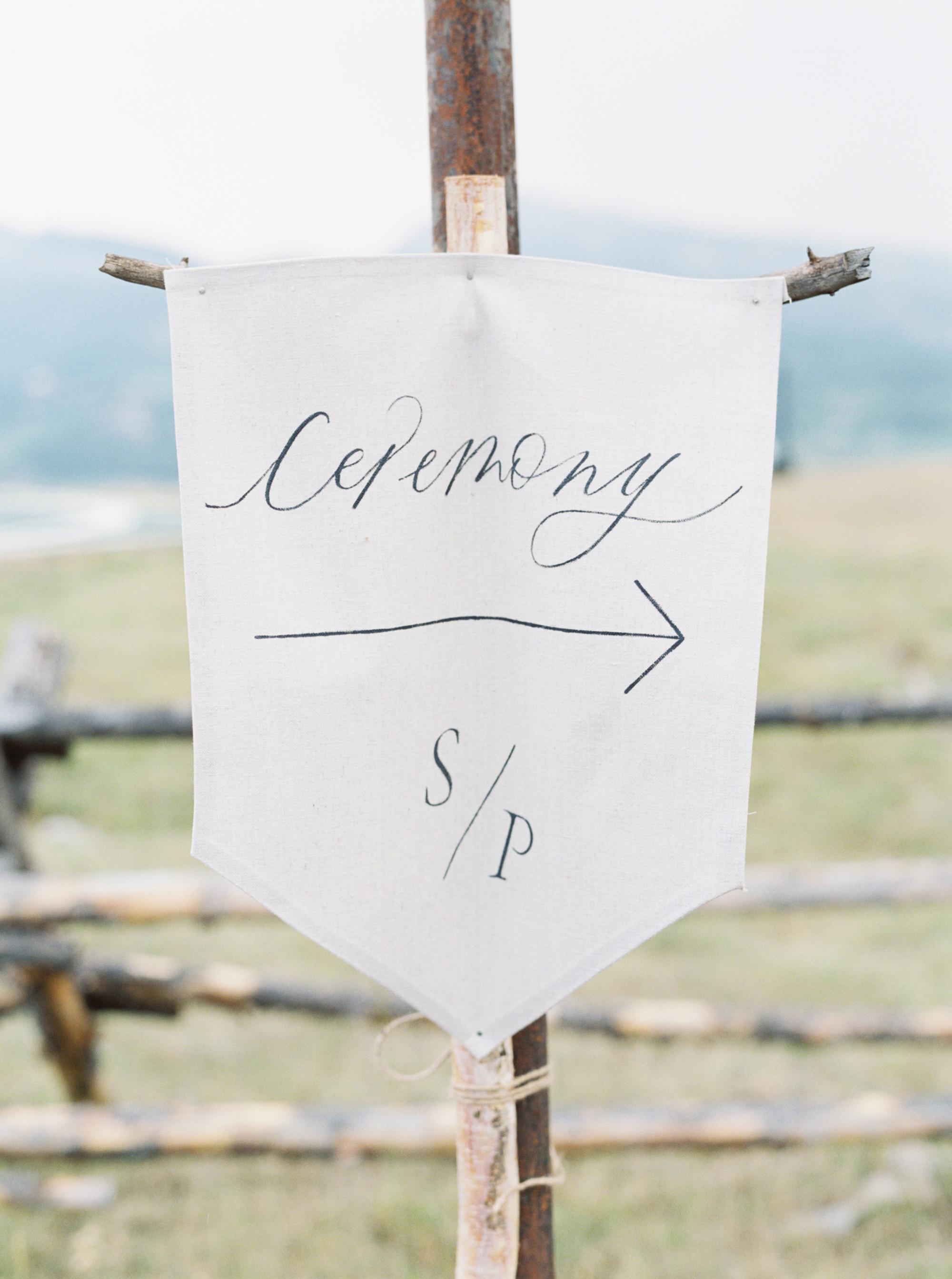 white linen wedding ceremony sign
