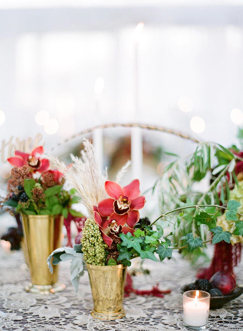 red pink floral centerpiece gold vases