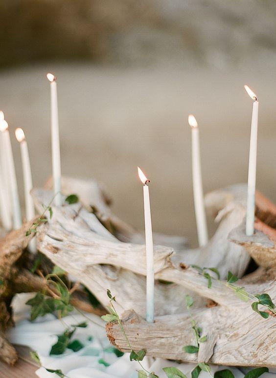 beach wedding ideas candles arranged on driftwood