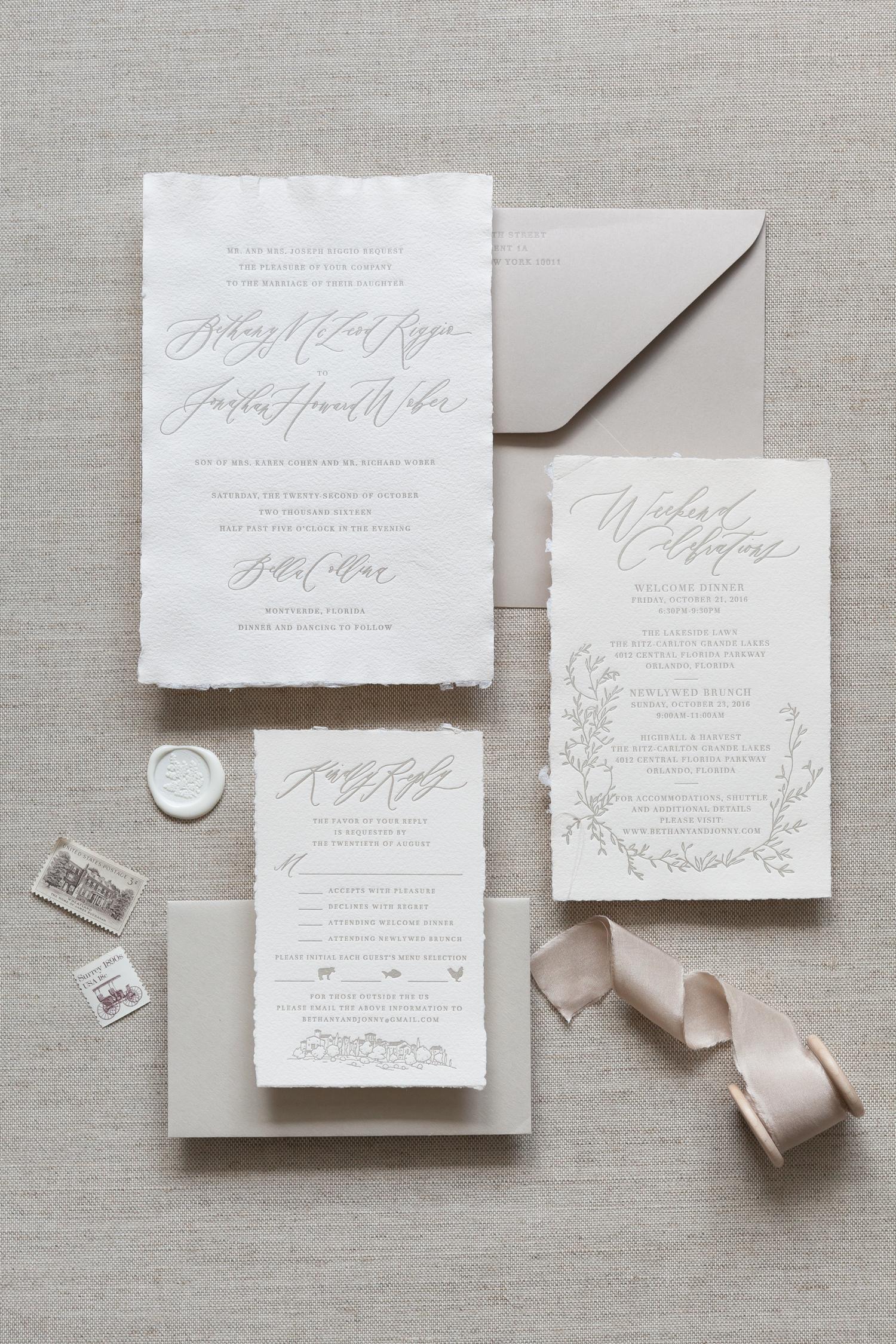 invitation with greenery motifs