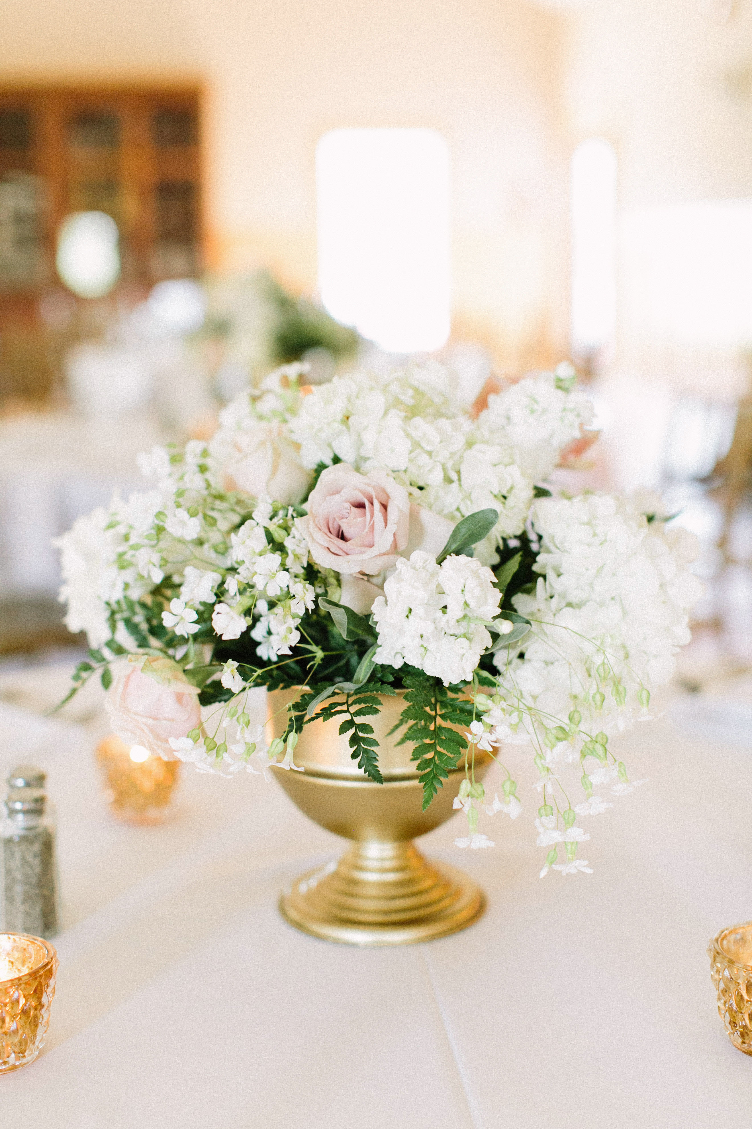glamorous wedding ideas gold vessel floral arrangement