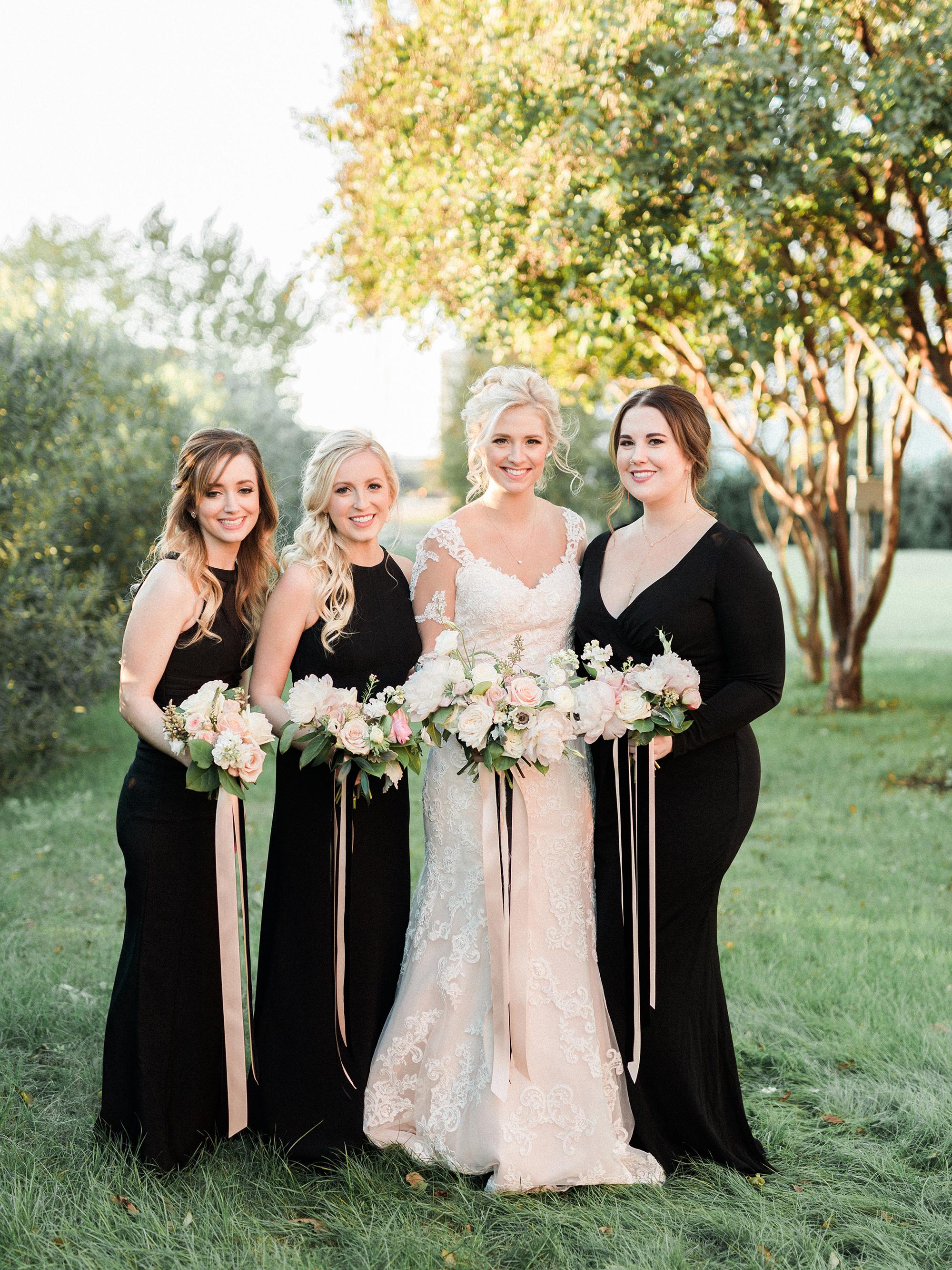 bride bridesmaids holding bouquets