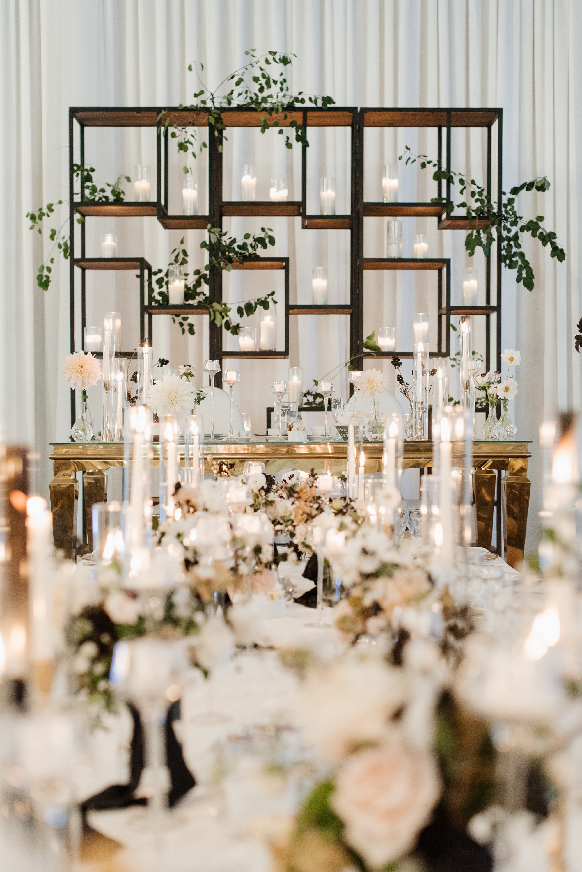 bridal table backdrop with candles and flowers